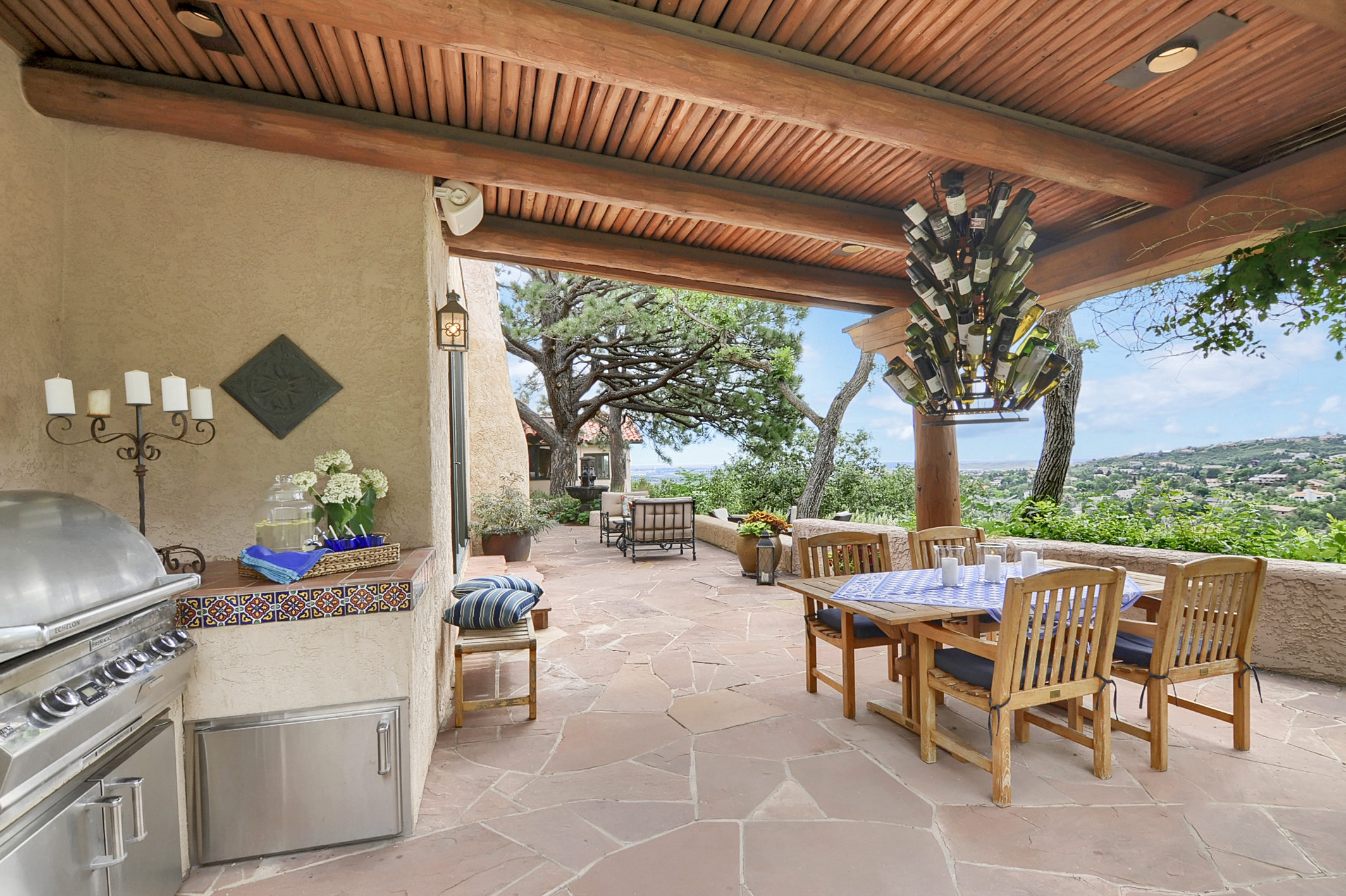 24 - Flagstone back patio has a pavilion with built in gas grill.jpg