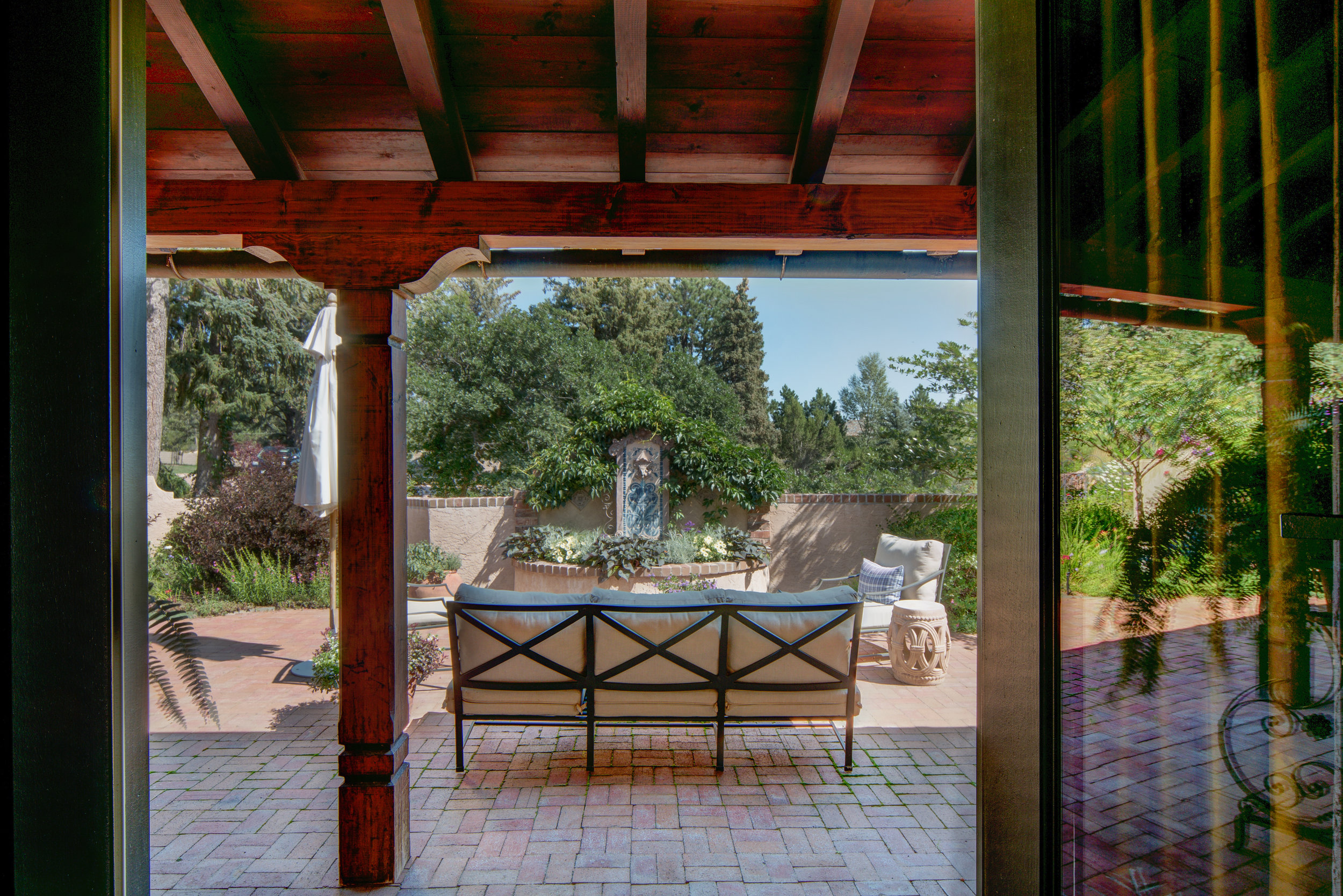 28 - Living Room's french doors open to front courtyard with fountain.jpg