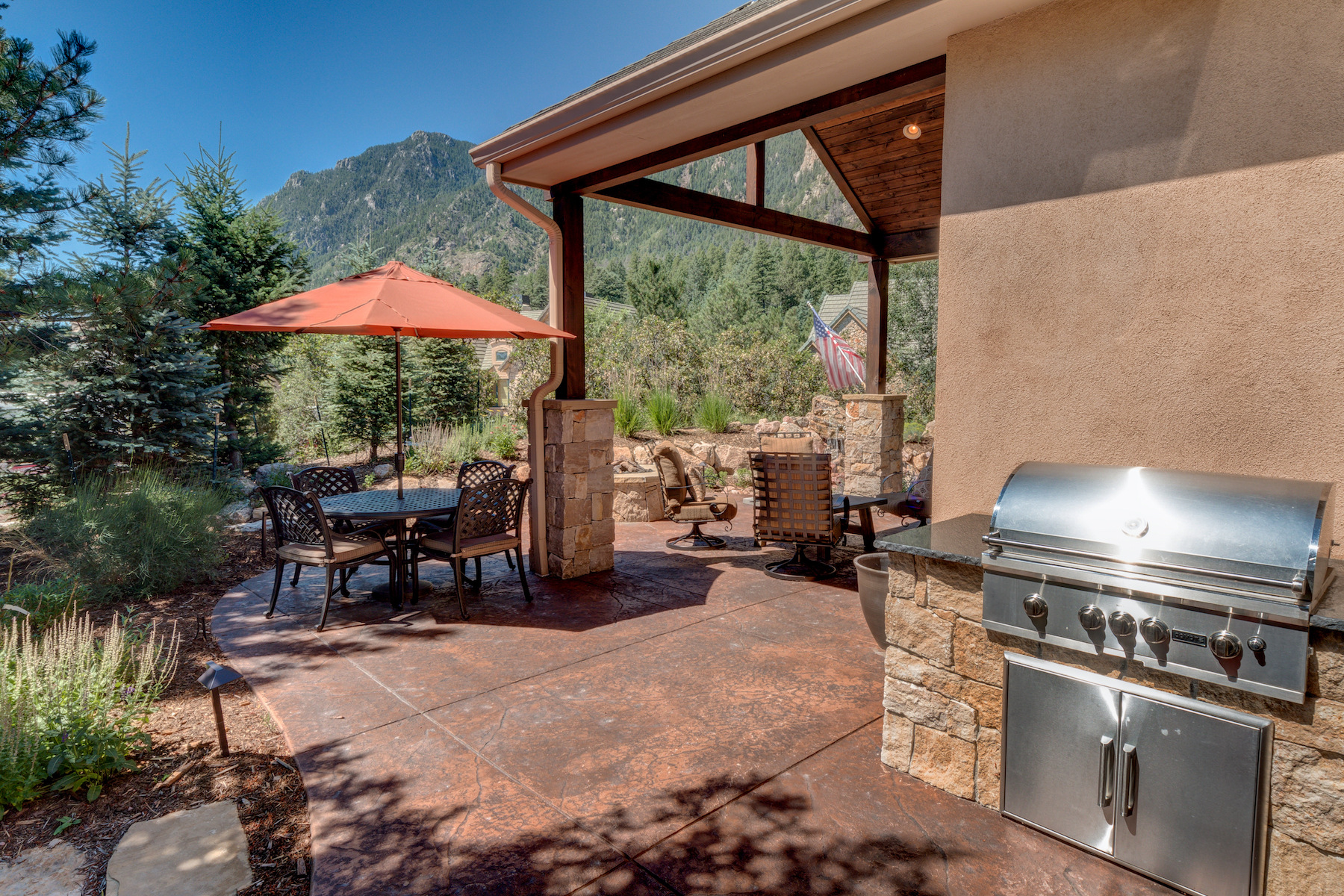 4 - Patio Wraps Around with Built in Gas Grill Next to Kitchen.jpg