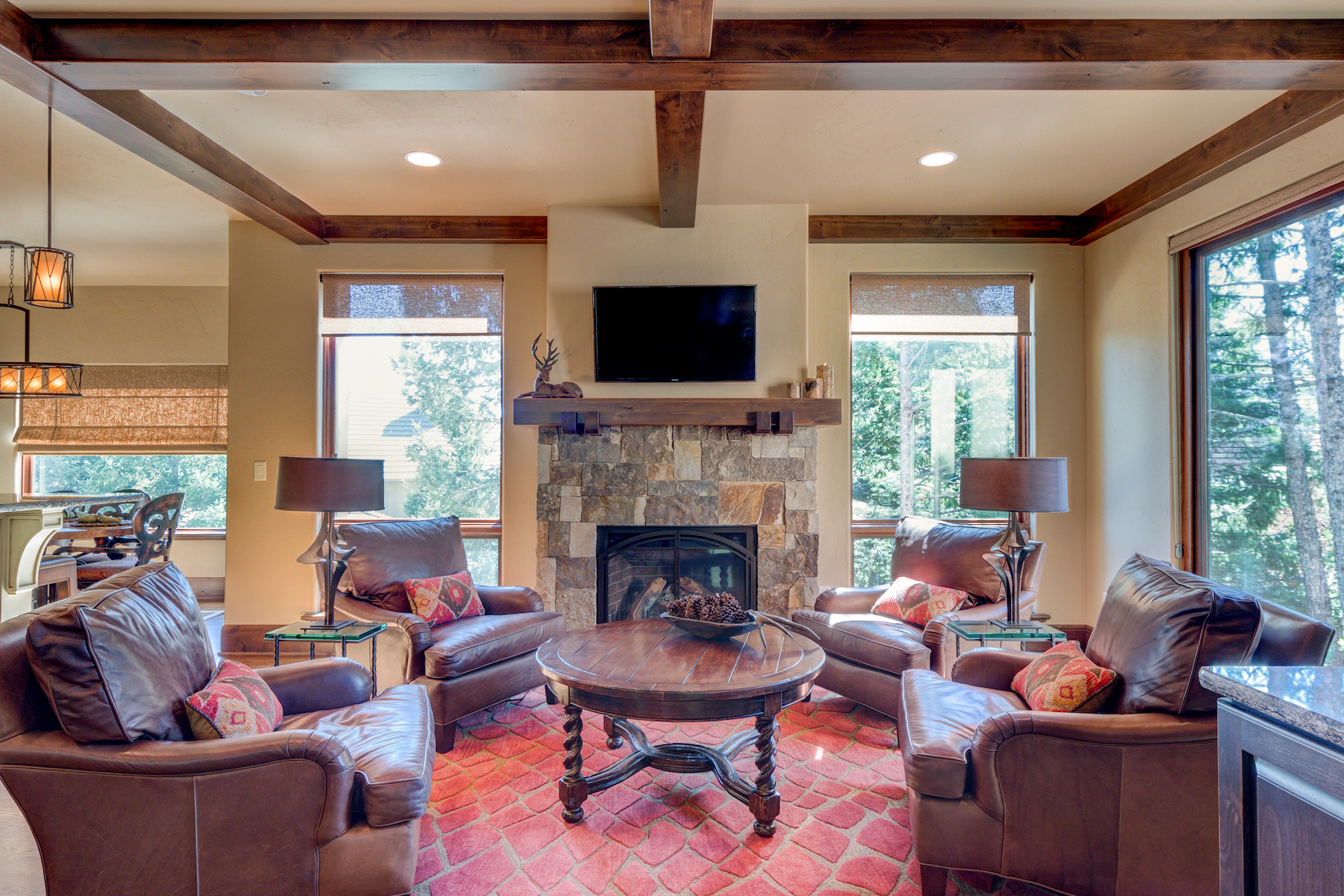 12 - Family Room with Fireplace, Beamed Ceiling, and Wet Bar.jpg