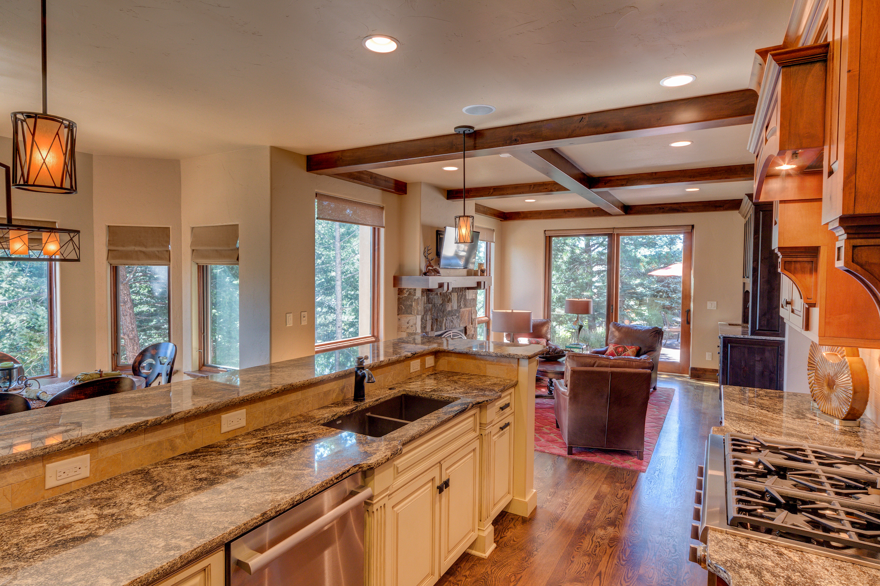 15 - Kitchen with Family Room Beyond.jpg