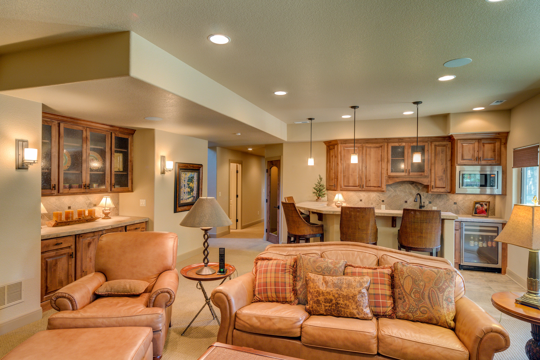 22 - Lower Level Rec Room with Wet Bar, Wine Closet, and Built in Buffet.jpg