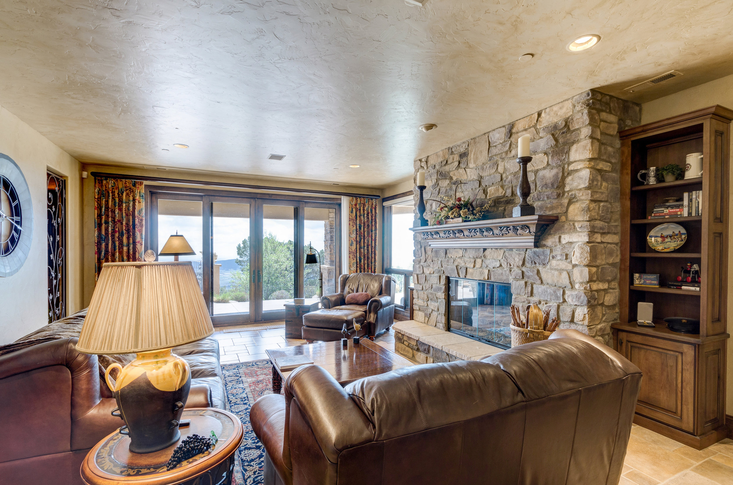 17-Family Room in Basement with wet bar and wine grotto.jpg