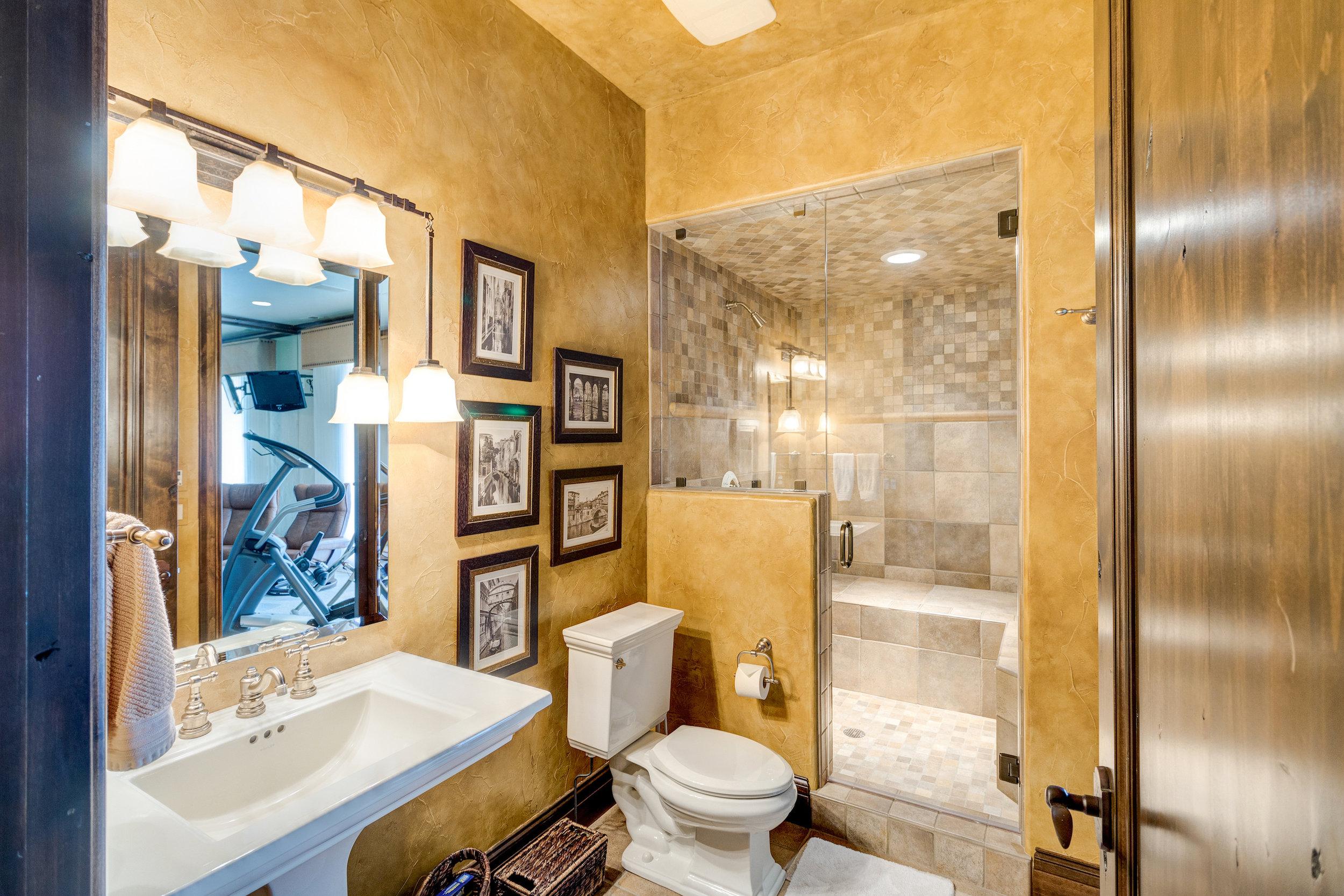22-Basement Bathroom with steam shower.jpg