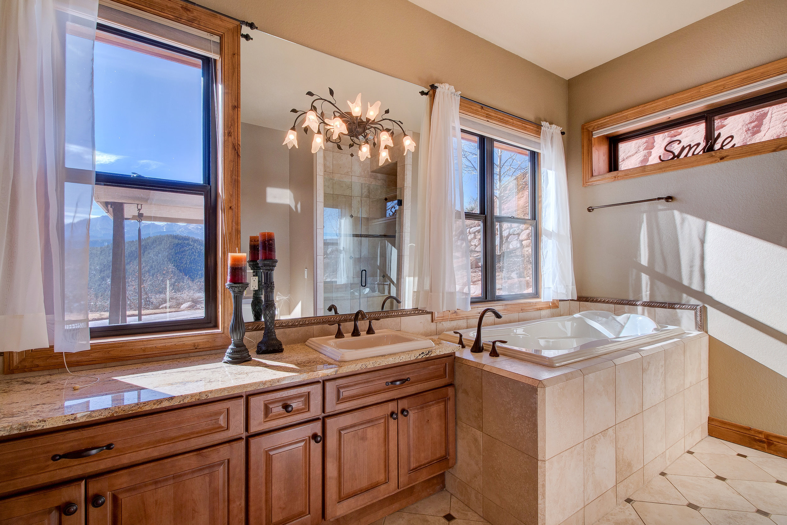 20-Her bath with soaking tub and tiled shower.jpg