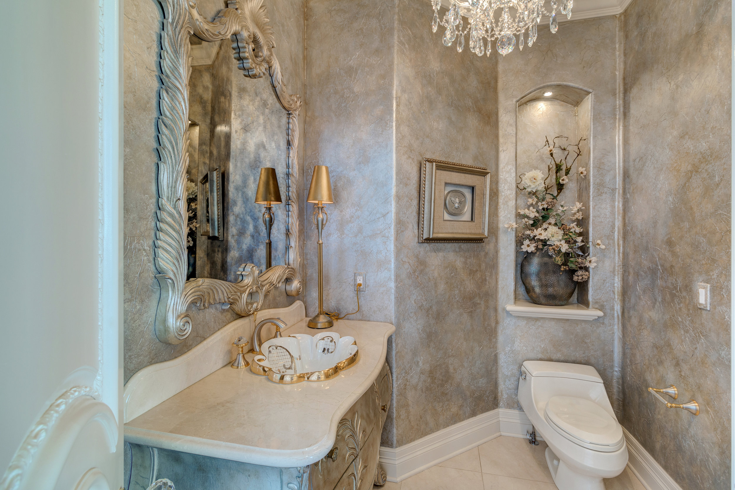 11-One of two powder rooms on main level.jpg