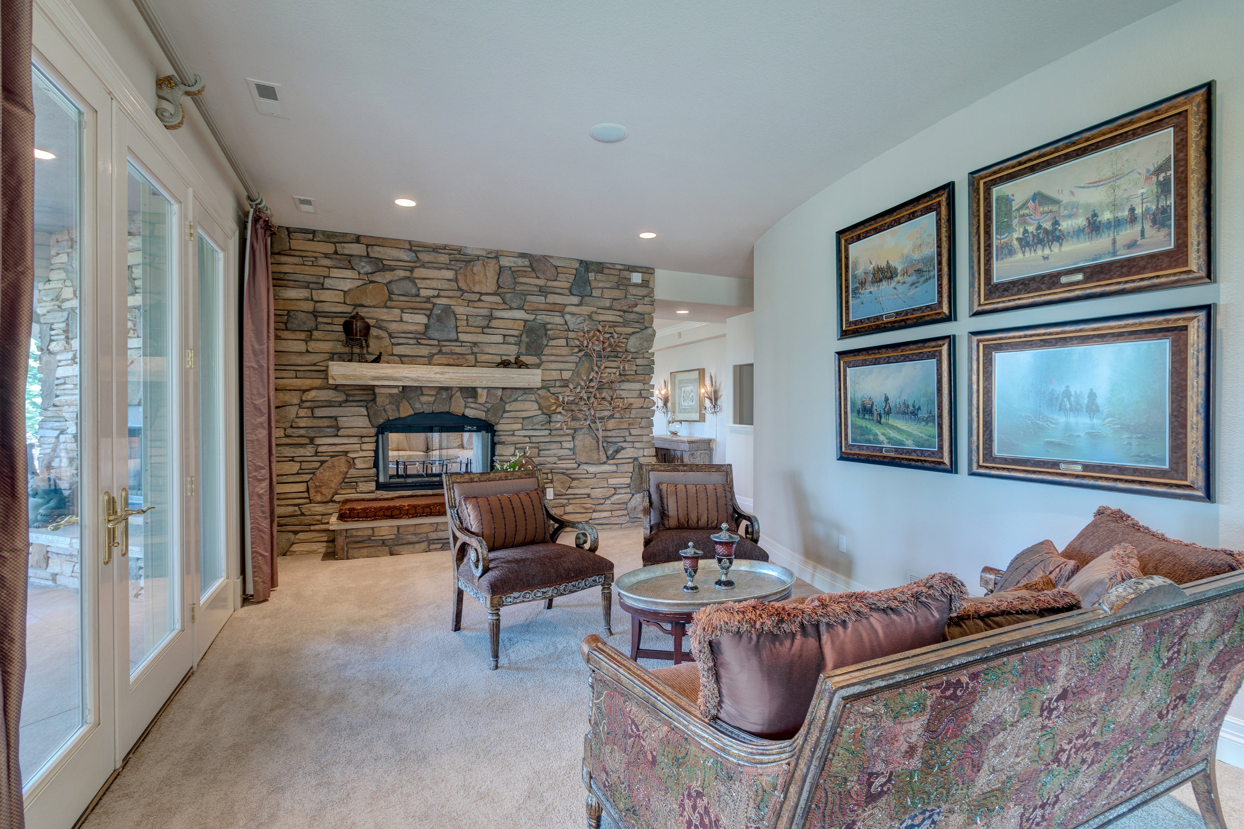 21-Cozy sitting area off the lower level's wet bar_ kitchen area.jpg