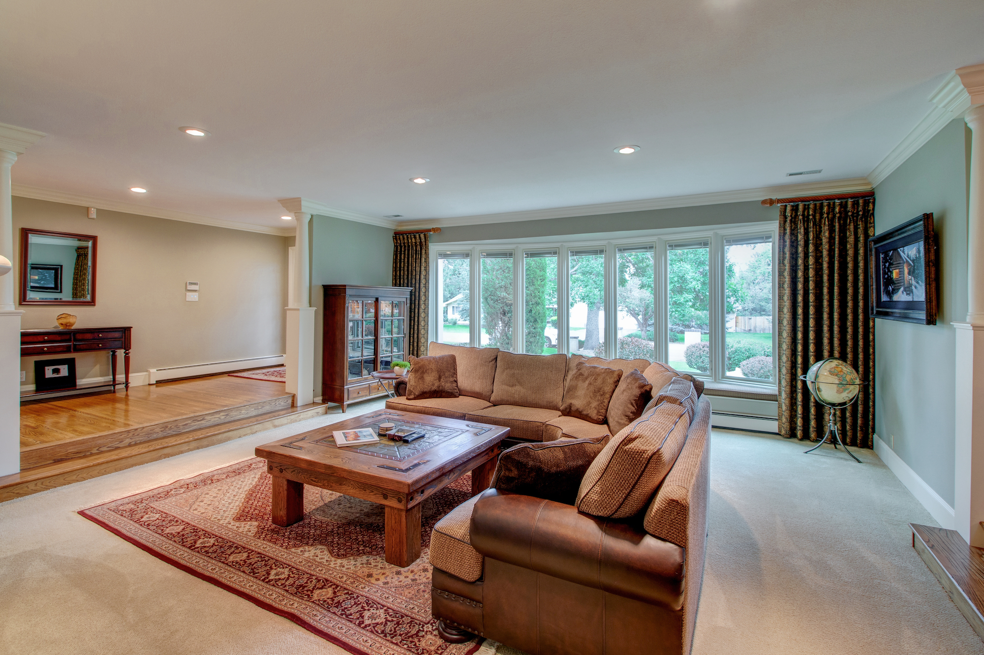 2-Living room has lovely bay window w seating bench.jpg