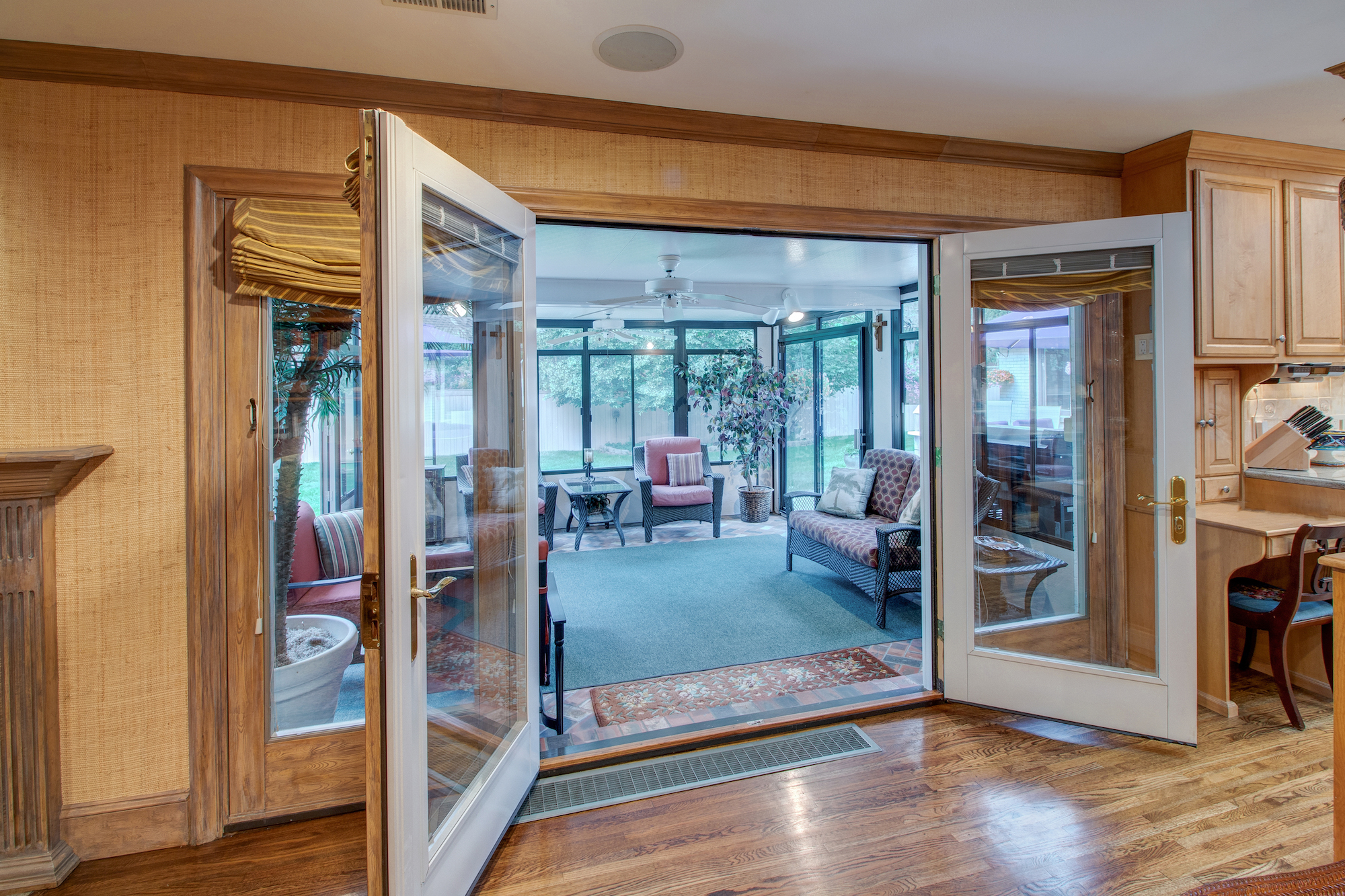 8-French doors in family room open to sunroom.jpg