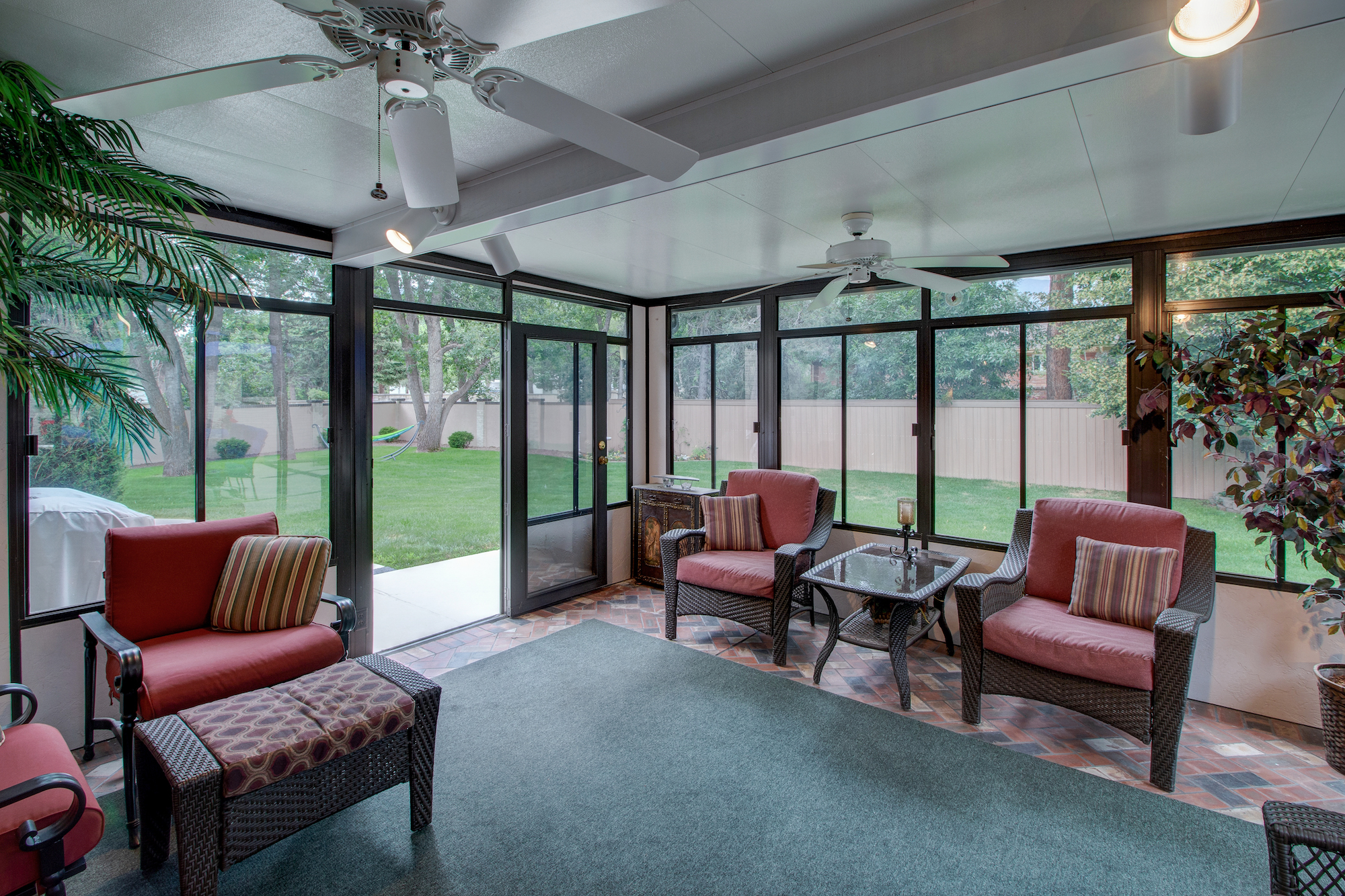 9-Sunroom opens to lush yard on the left.jpg