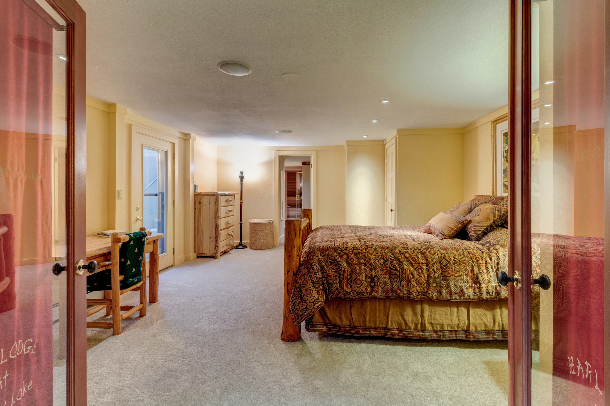 22-Lower level guest suite w separate outside entrance and adjoining bathroom.jpg