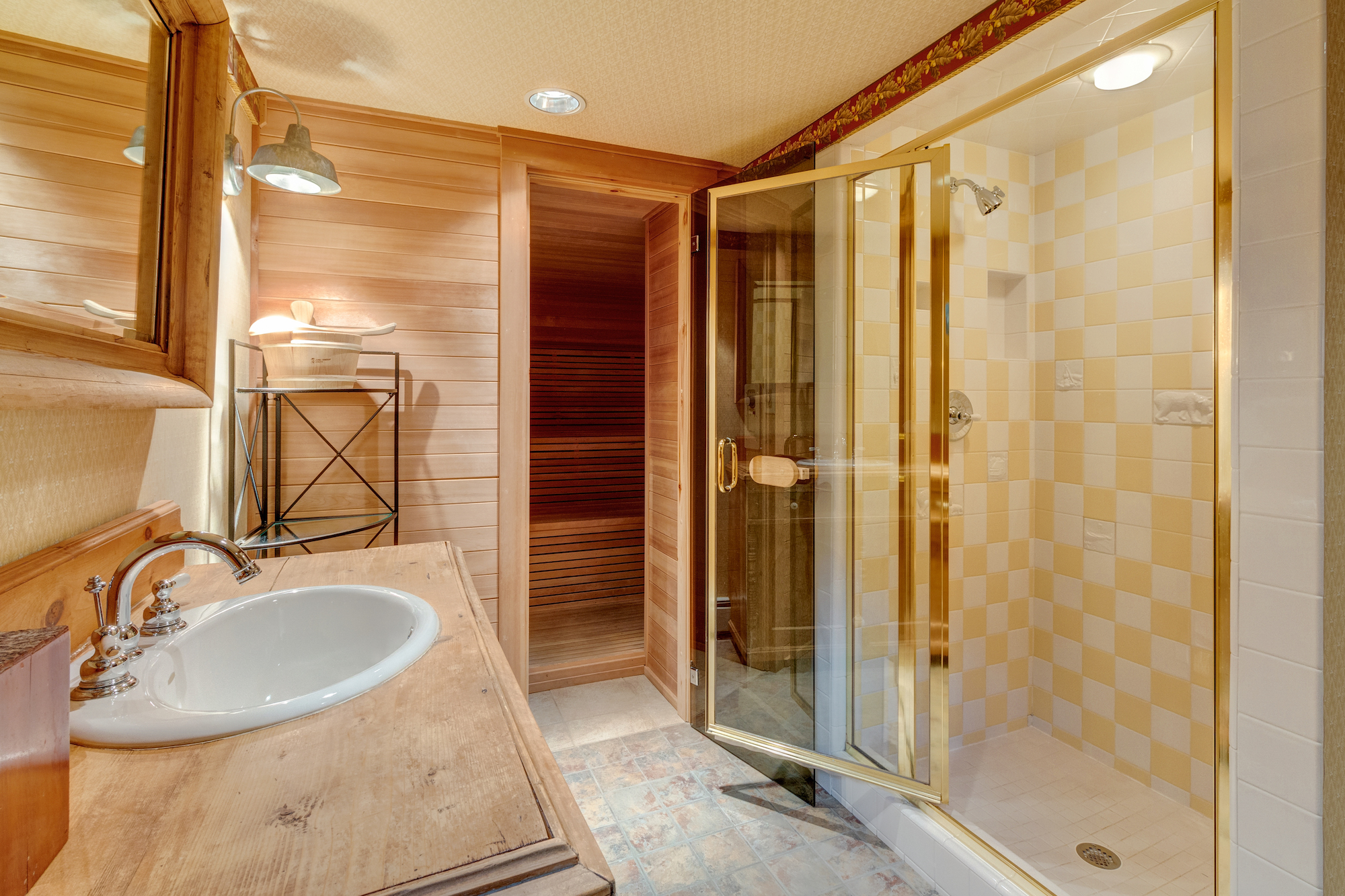 23-Lower level guest bath with shower and sauna.jpg