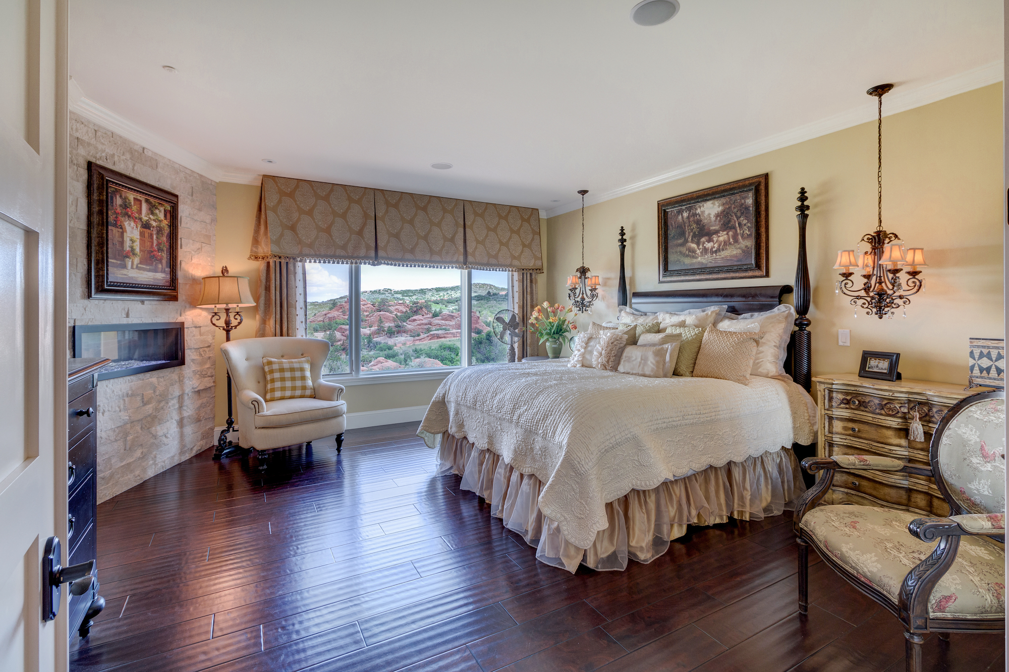 014-Master bedroom with fireplace that also opens to master bath.jpg