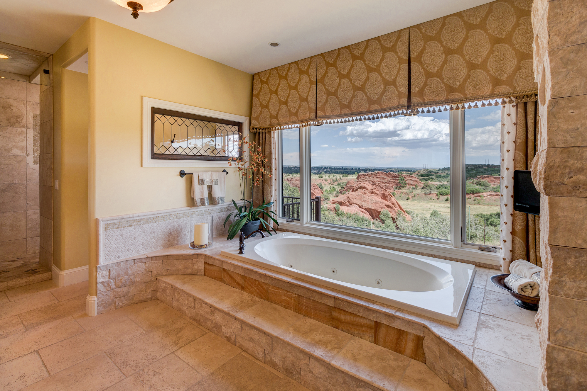 015-Jetted tub in master bath. Window has a remote controlled blind.jpg