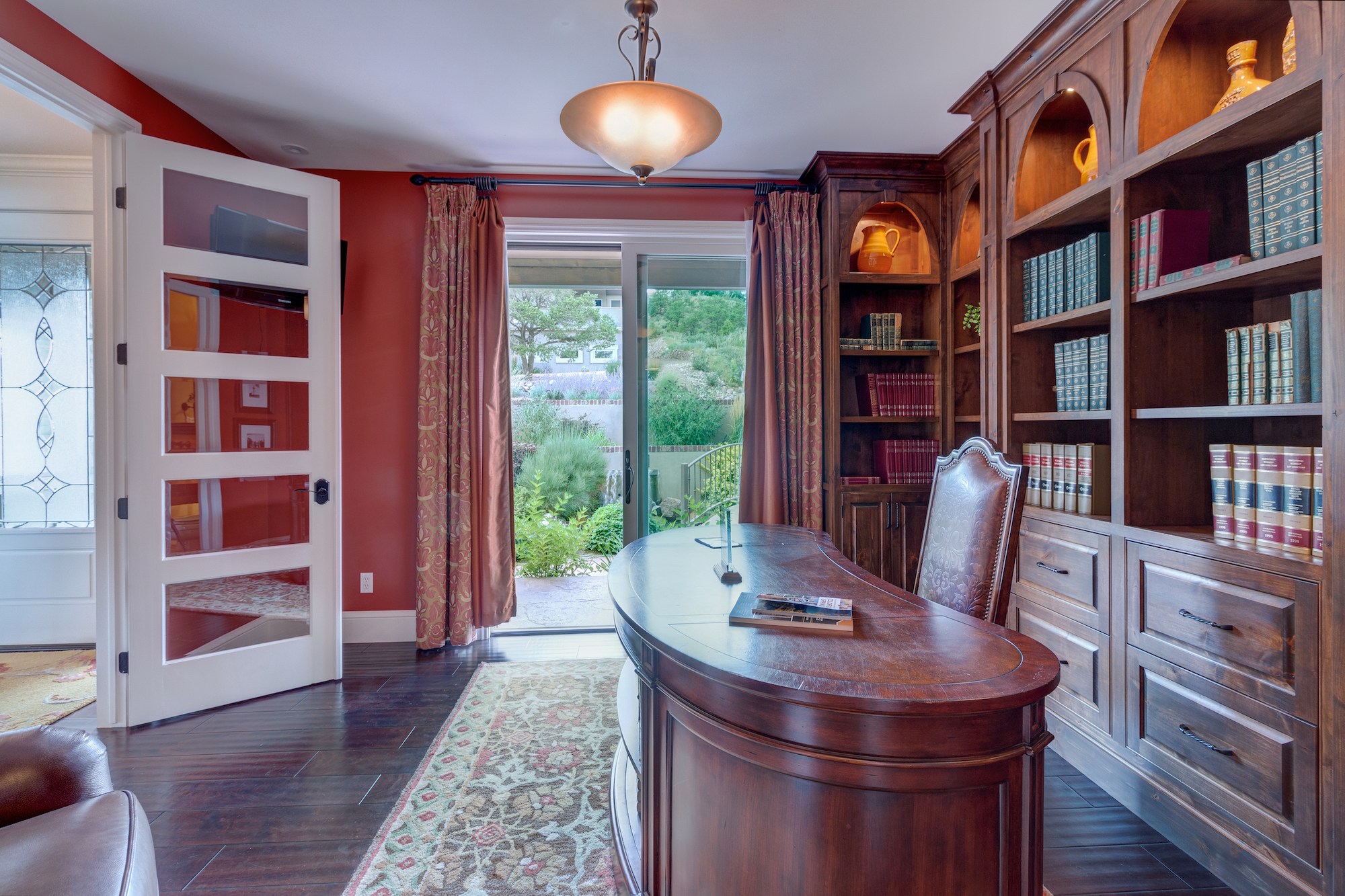 017-Office with bookcases and slider that opens to stream and water feature.jpg