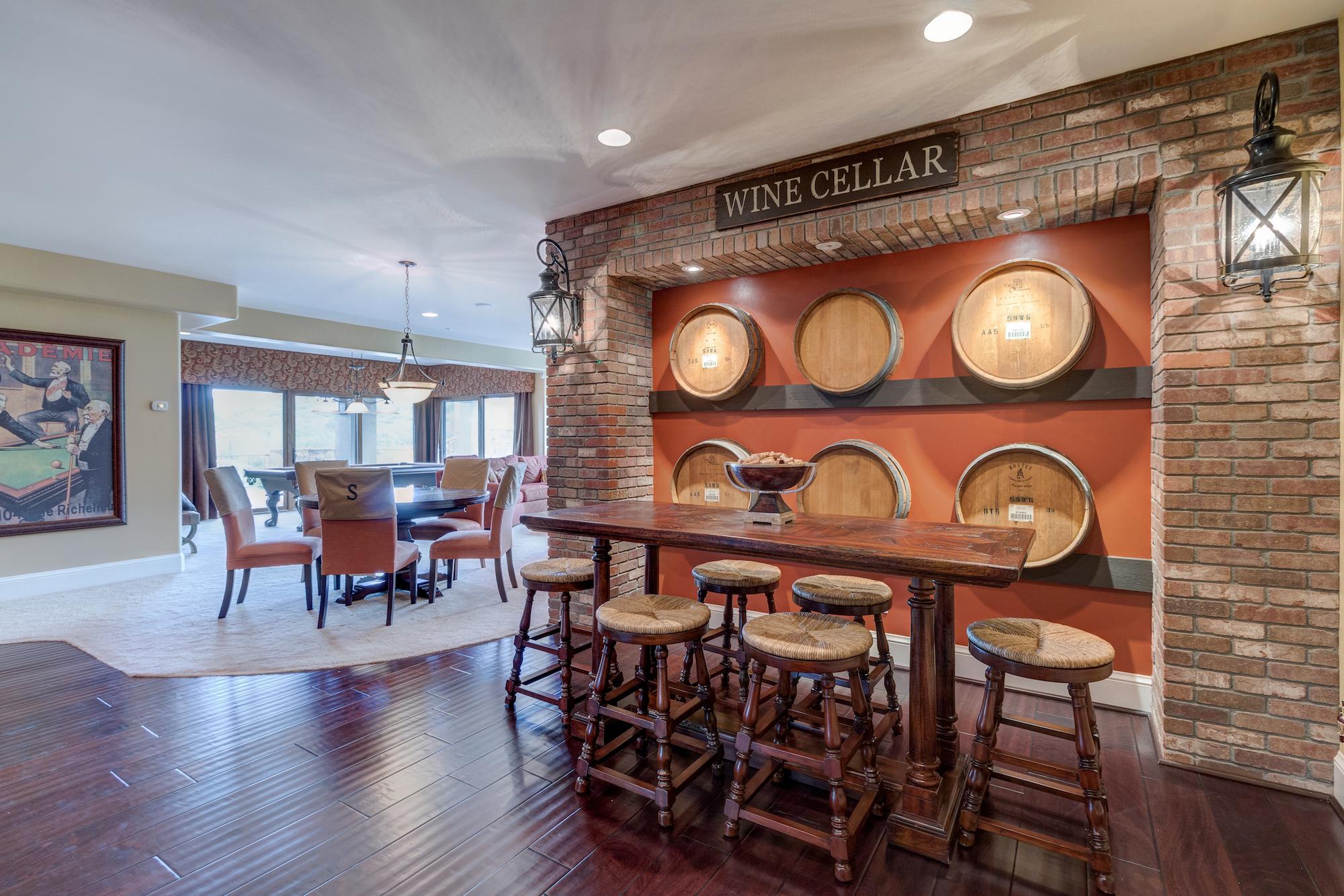 019-Family room in basement w wet bar and wine tasting area.jpg