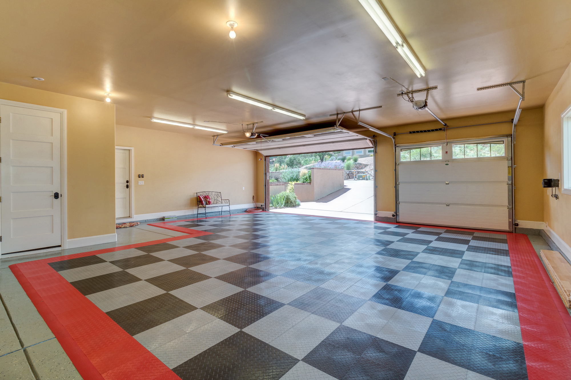 035-Finished garage with race car floor mat and storage area.jpg