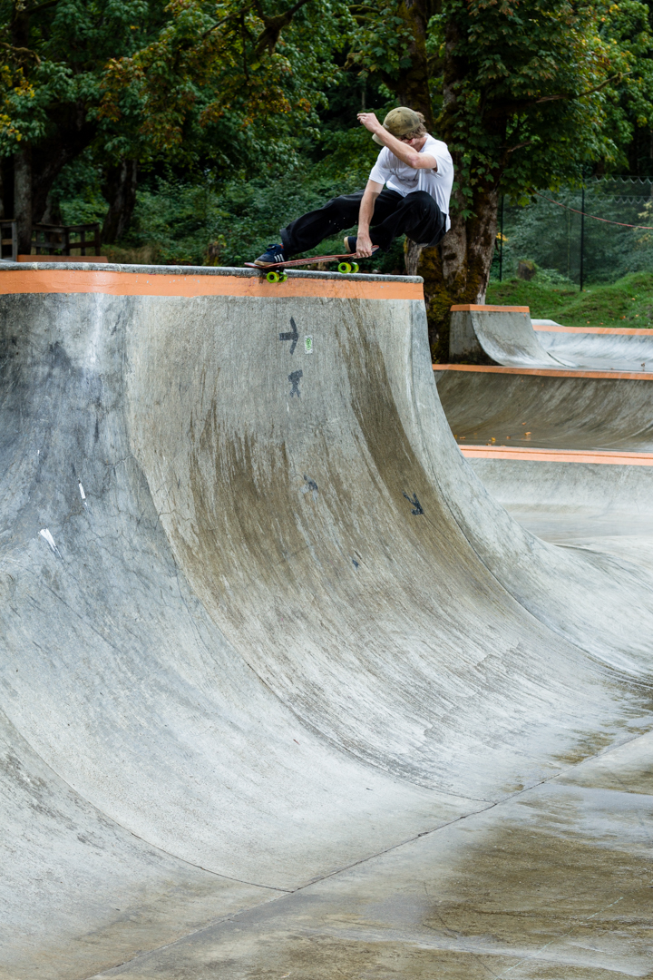 Started raining a few minutes into our session at skate camp, here's me making the best of it on Elijah's cruiser board. Could barely get those soft wheels to slide on this crail -