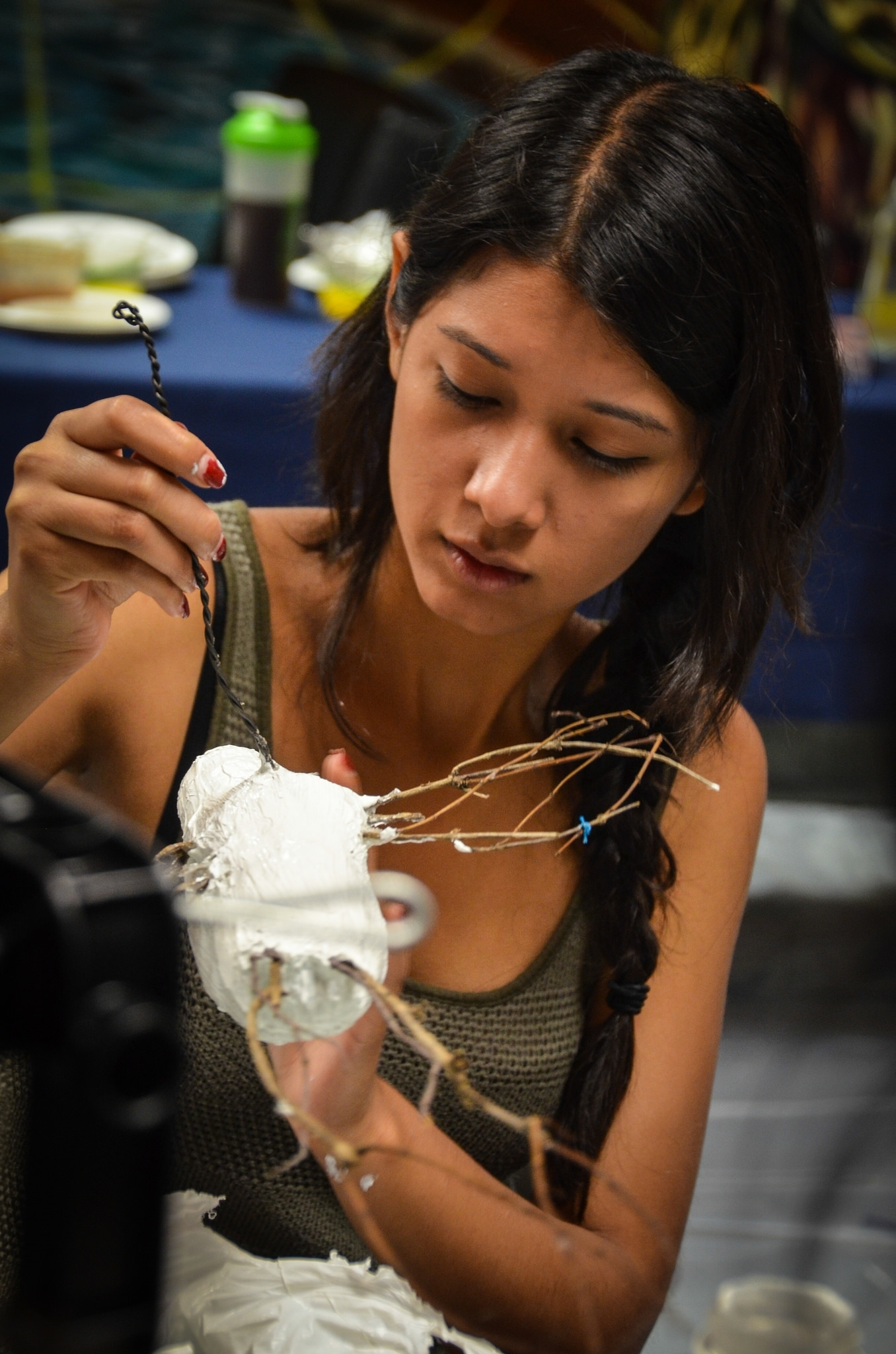 Yaritza Guillen working on a sculpture.