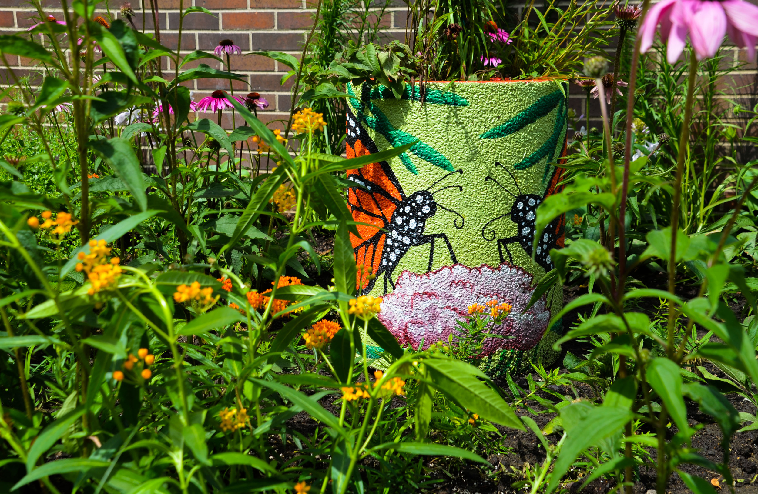Pollinator urn picture with Monarch butterfly