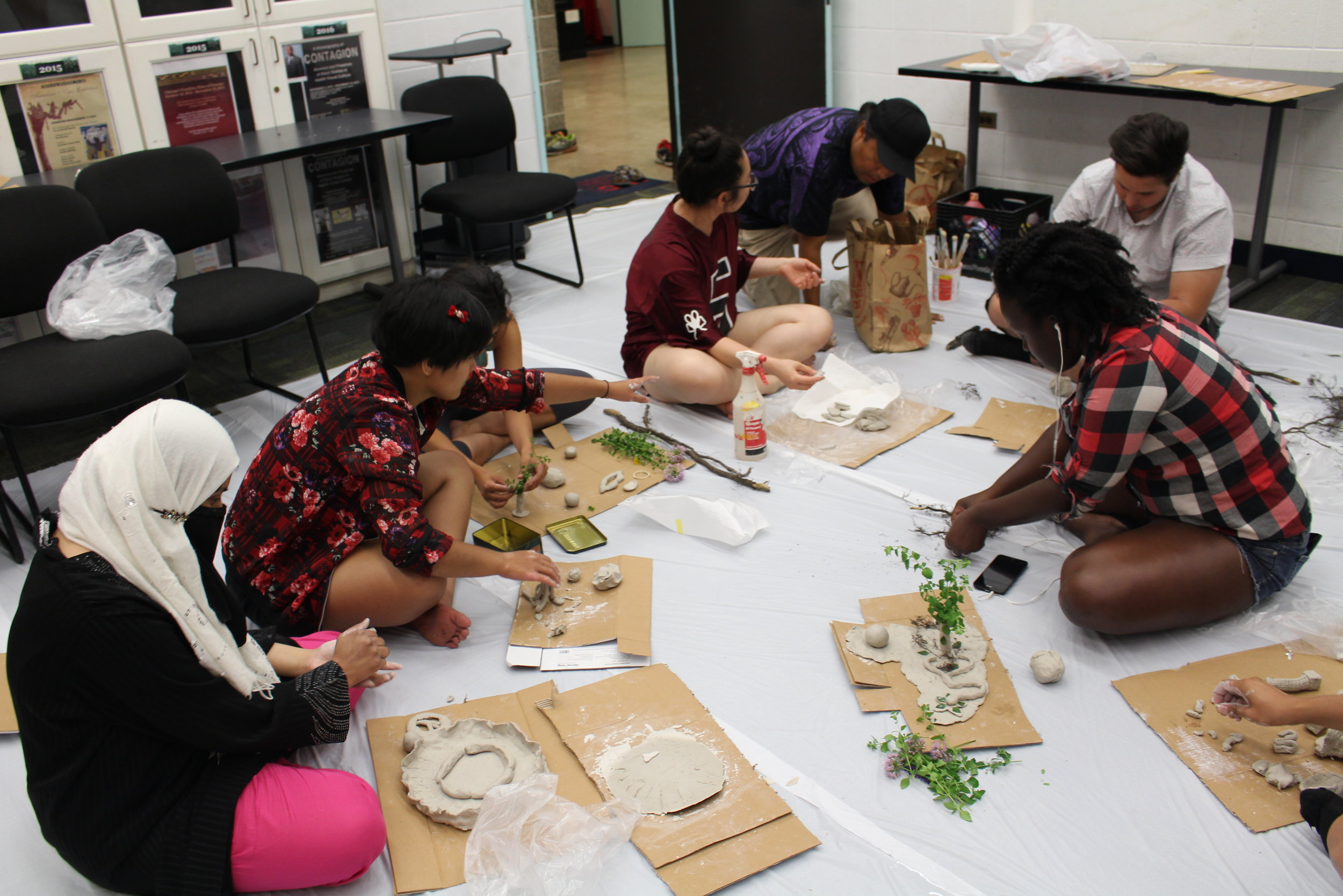 Picture of Heritage Gardeners working on clay sculptures
