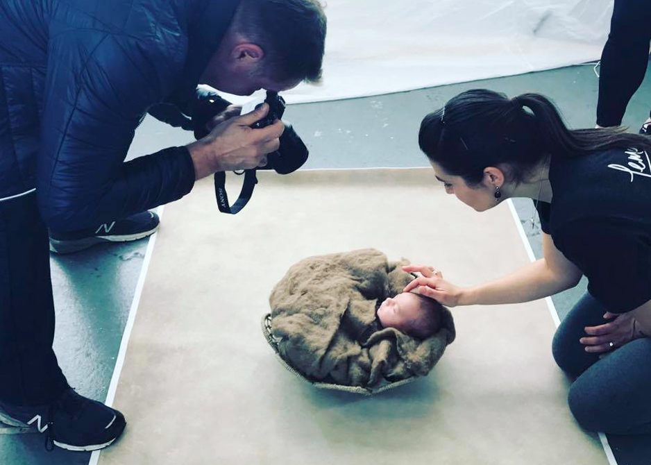 Making sure baby was safe and adorable for the student photographers. Photo Credit: Ana Brandt