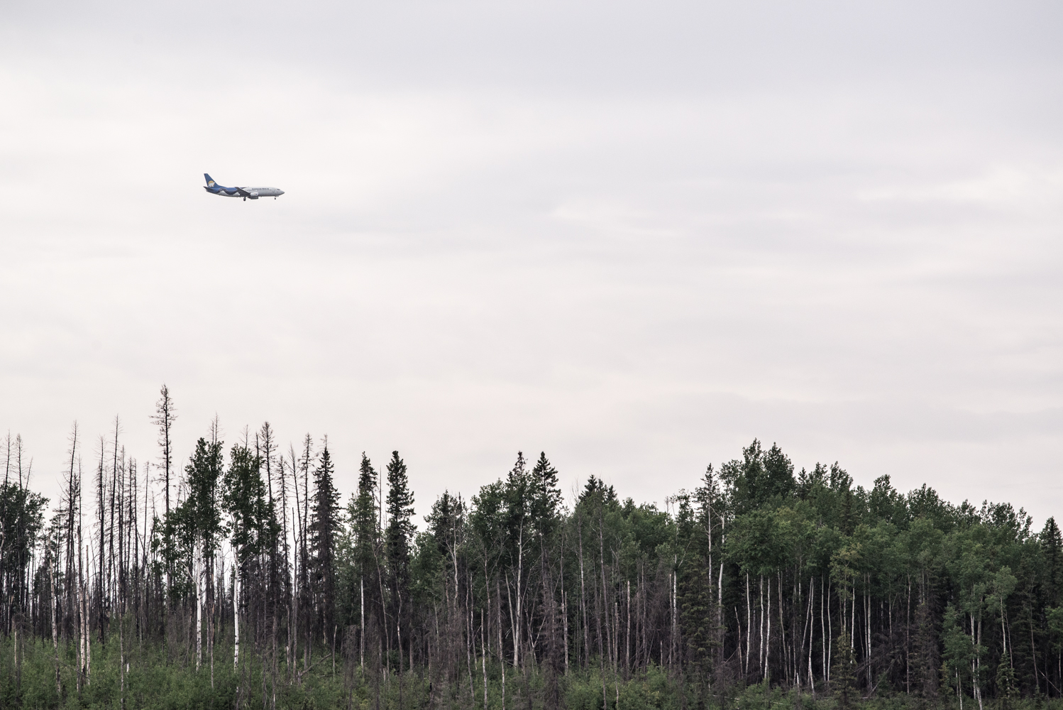 Airplane approaching the Canadian Natural Resources Limited Horizon Mine, July 2017.