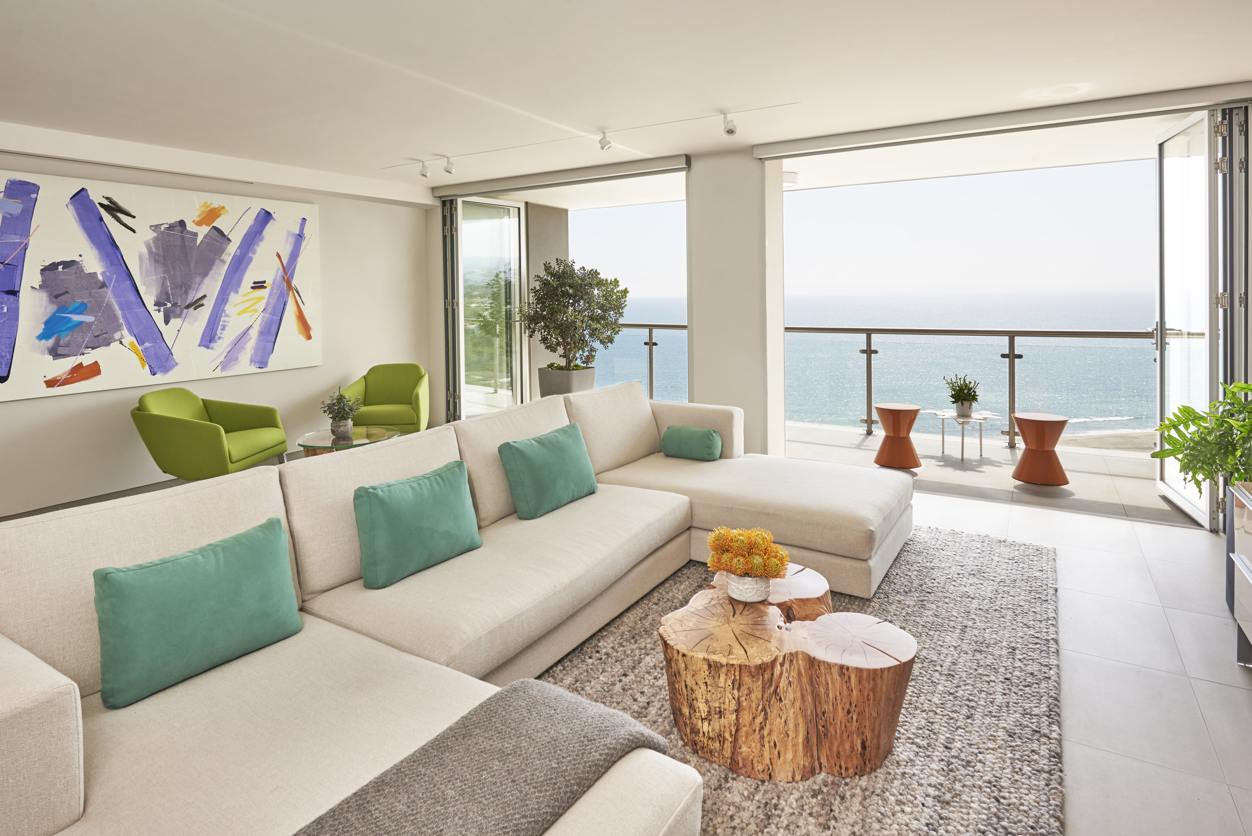 Fresh and fun colors come to life in the  open air media room . The locally made sectional sofa was designed to fit the homeowner's specific desires: all natural & non-toxic materials, handmade in California. Photo by Steven Dewall.
