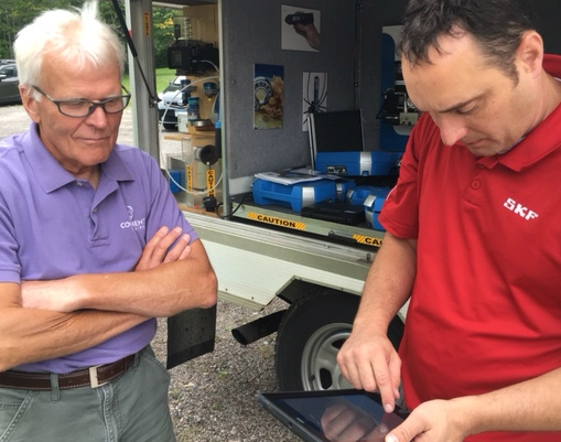 Founding Owner, Bill Howard working with SKF Industrial Tech, Brandon Berg