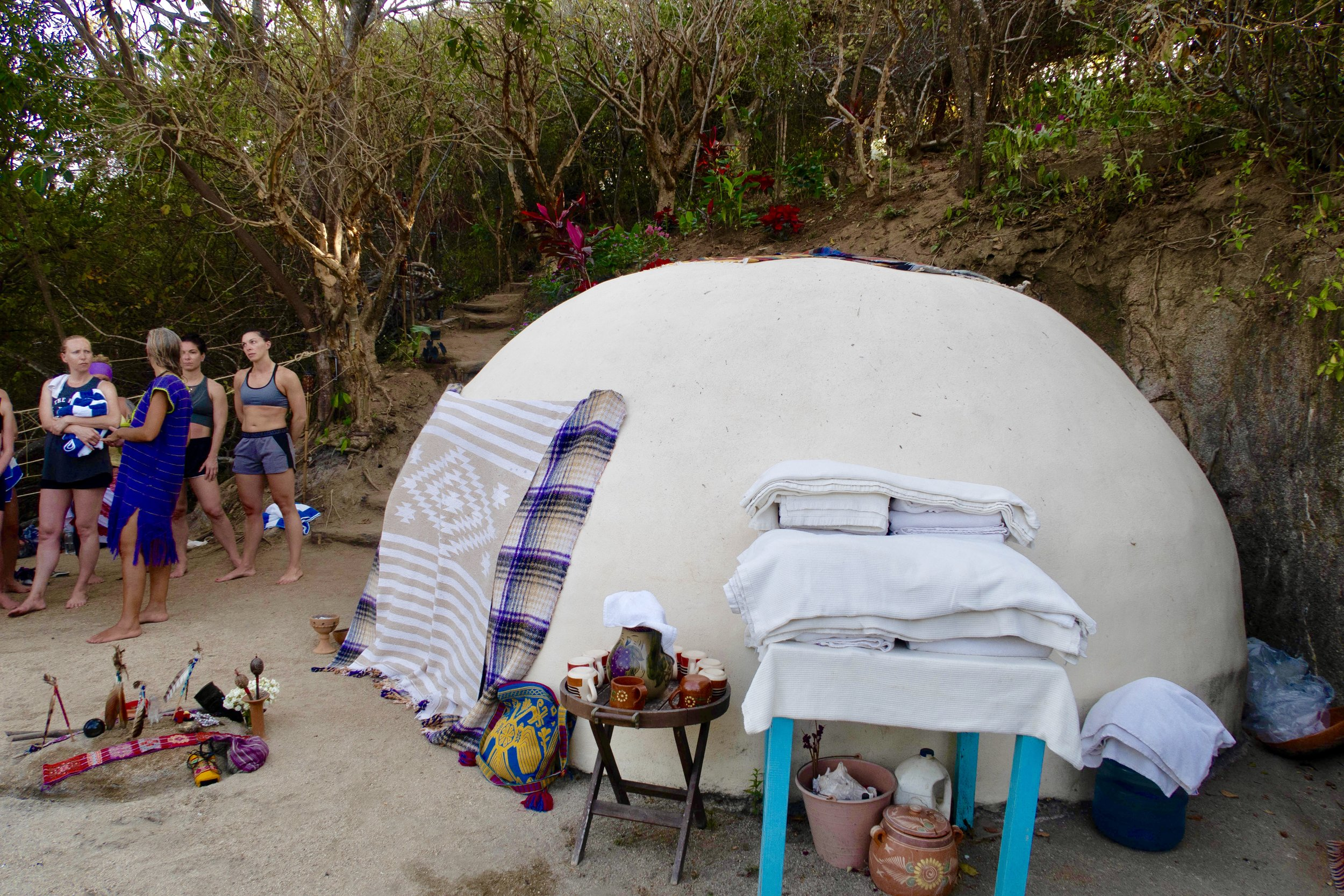 The ancient healing sweat lodge ceremony womb. Offered (completely optional!) to shed old ways of being and to let our jungle souls free.