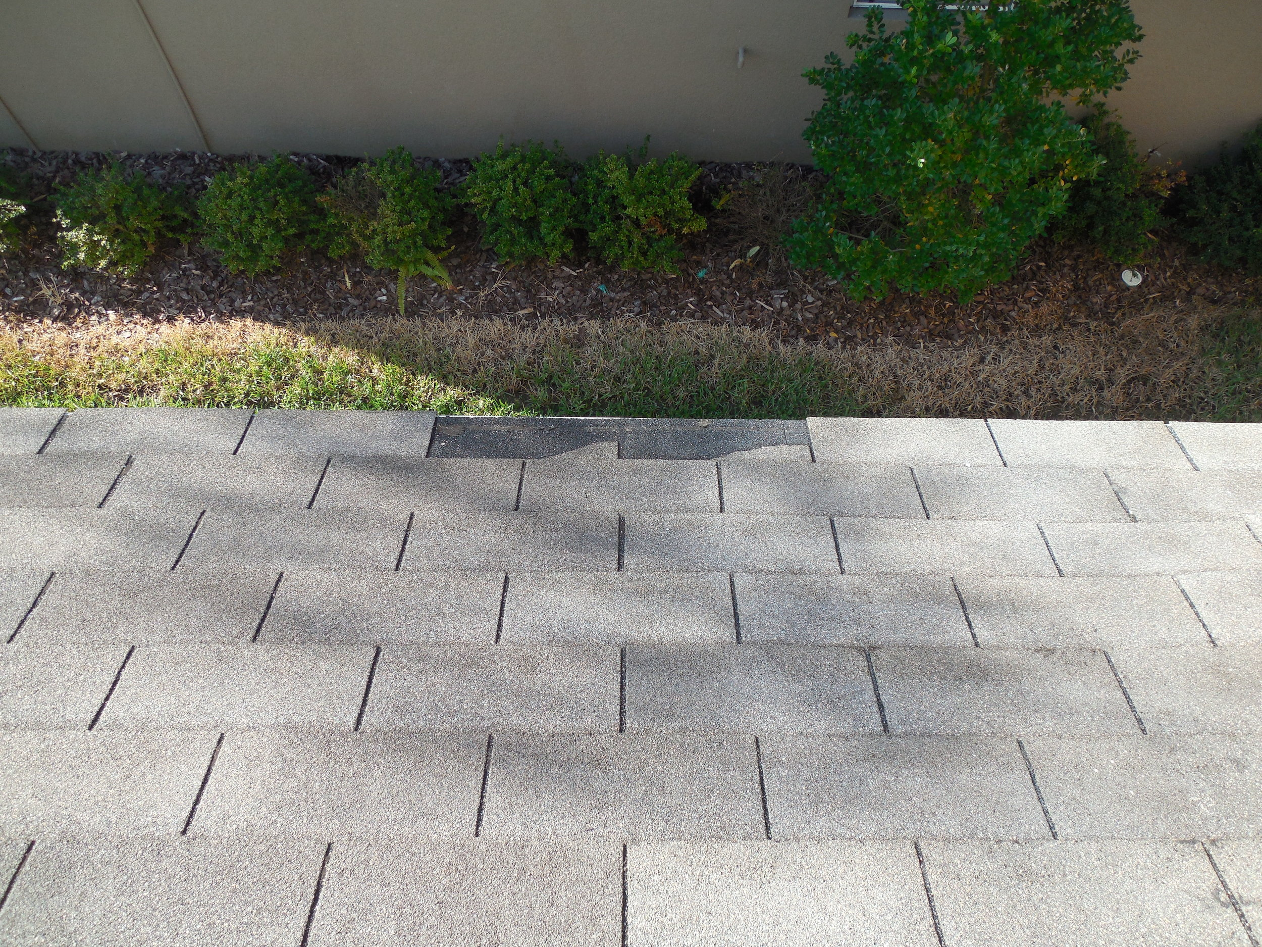 Missing shingles on a new construction home. Even new construction homes need inspections.