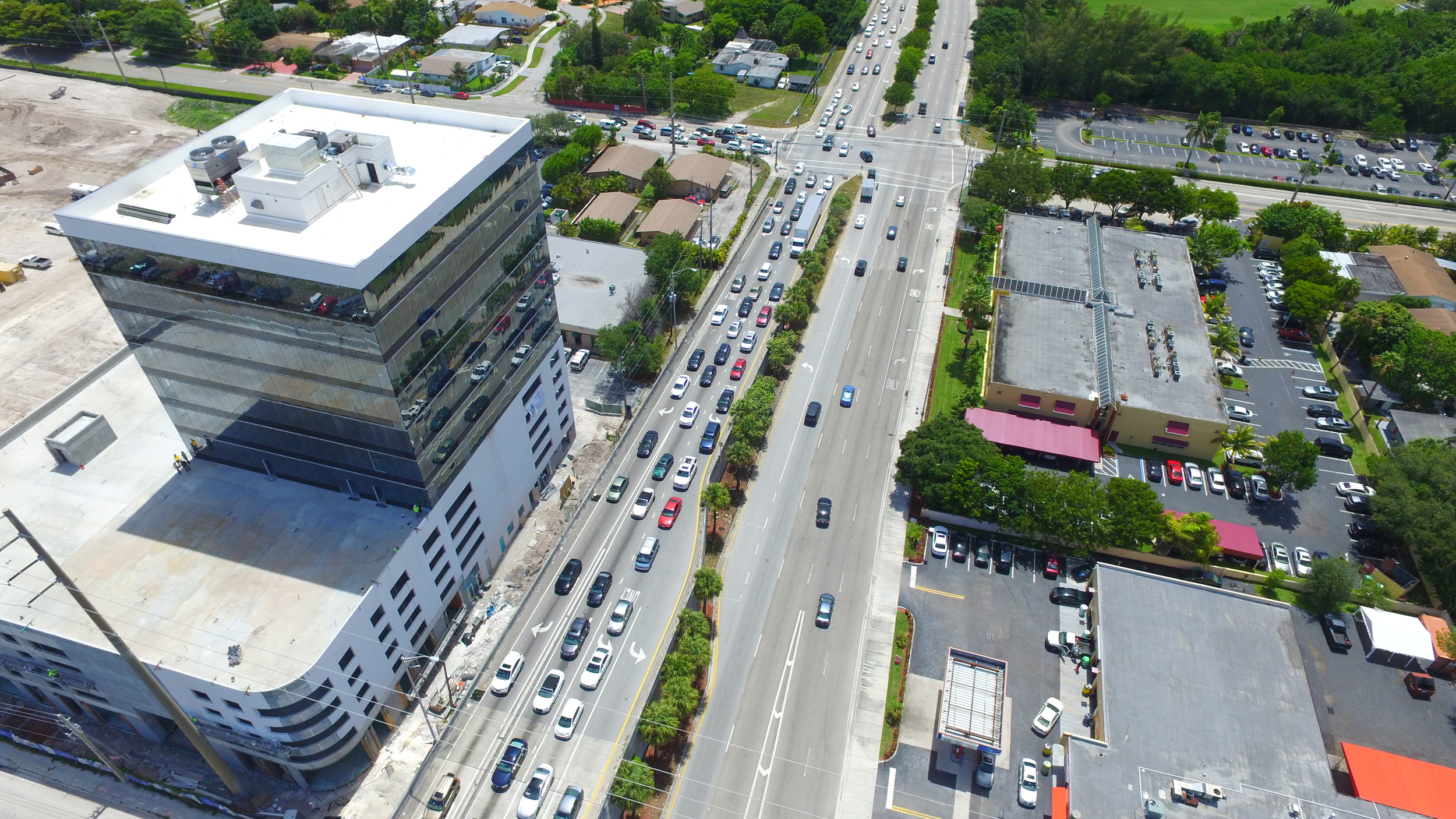 Traffic on Ives Dairy Rd by Beacon Tower of Aventura.
