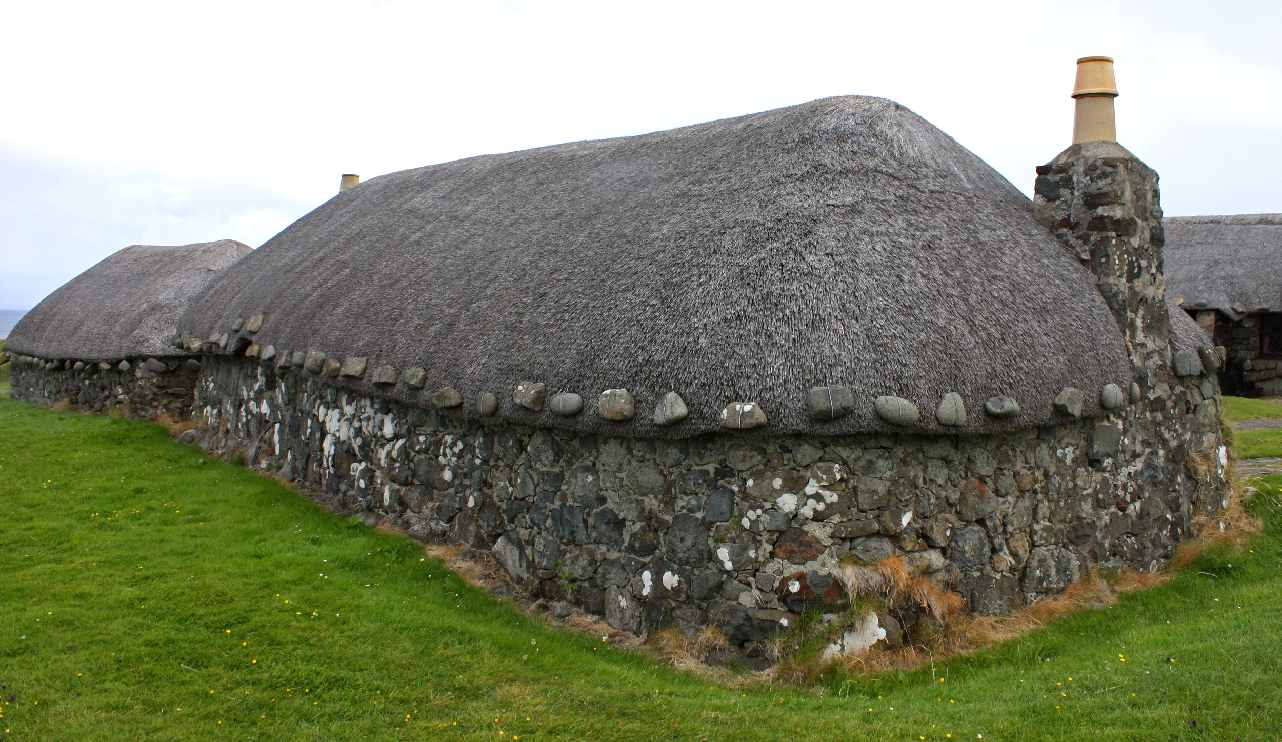 "The ""tigh dubh"" or ""black house"" is a low set stone building with thatched roof that was common in the Scottish Highlands, the Hebridean islands and Ireland. They are most often associated with crofting (farming)"