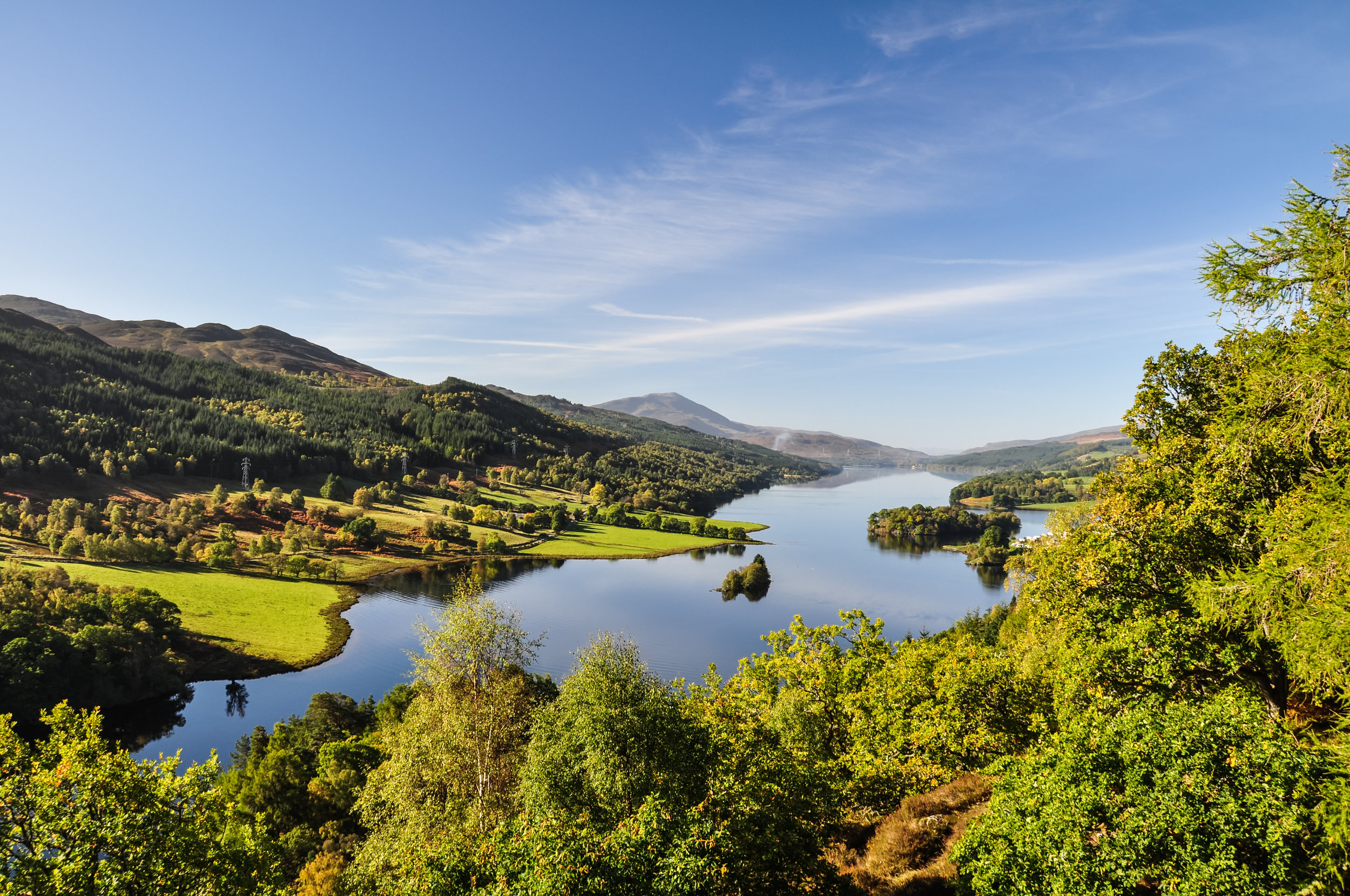 Beautiful summer view across Loch (Lake) Tummel seen from Queen's View, a famous viewpoint. Located near Pitlochry, Perthshire, Scotland, UK. Perthshire is the region of Scotland that has been home to Dougie MacLean since his birth.