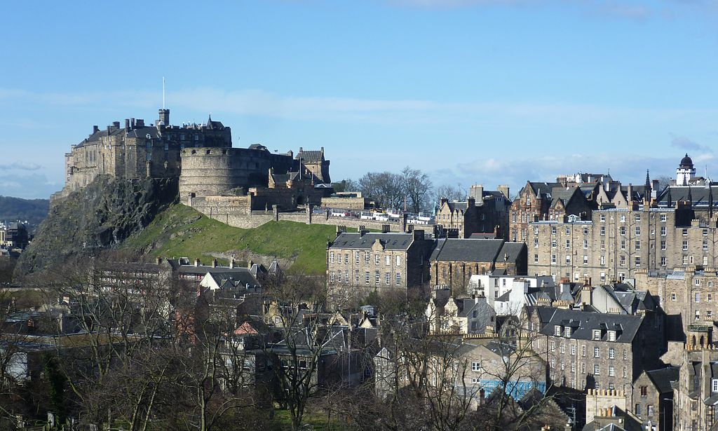 Edinburgh Castle seen from the roof of the National Museum of Scotland. The medieval burgh grew along the ridge sloping down from the castle. The castle is often considered the Number 1 tourist attraction in all of Scotland.  By Kim Traynor (Own work) [CC BY-SA 3.0 (http://creativecommons.org/licenses/by-sa/3.0)], via Wikimedia Commons
