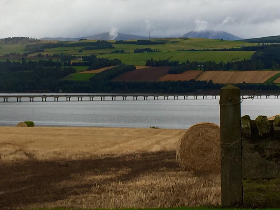 The Black Isle is not an island as its name implies, it is instead a peninsula  surrounded on three sides by water – the  Cromarty Firth   to the north, the  Beauly Firth   to the south, and the    Moray Firth   to the east. (Wikipedia) View from the Black Isle across the Cromarty Firth. Photo by author.