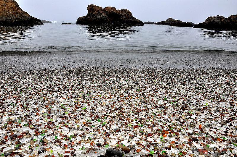 Sea Glass Beach, Fort Bragg, California, USA is one of the world's most popular locations for sea glass fans. Three glass factories once operated here through the decades and account for the enormous amounts of glass found here. Part of the beach is a state park and collecting is restricted.