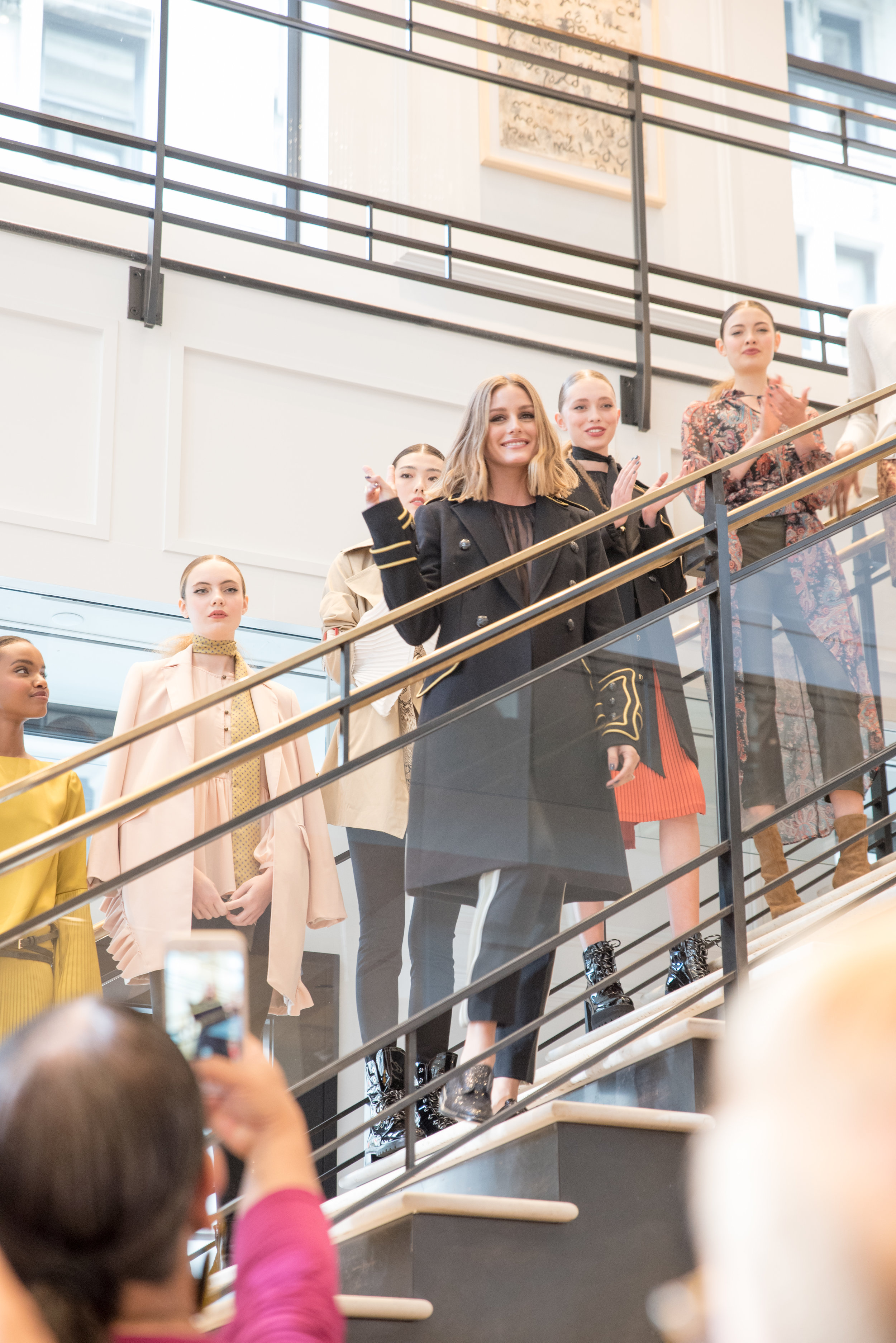 Designer and models showcasing the collection