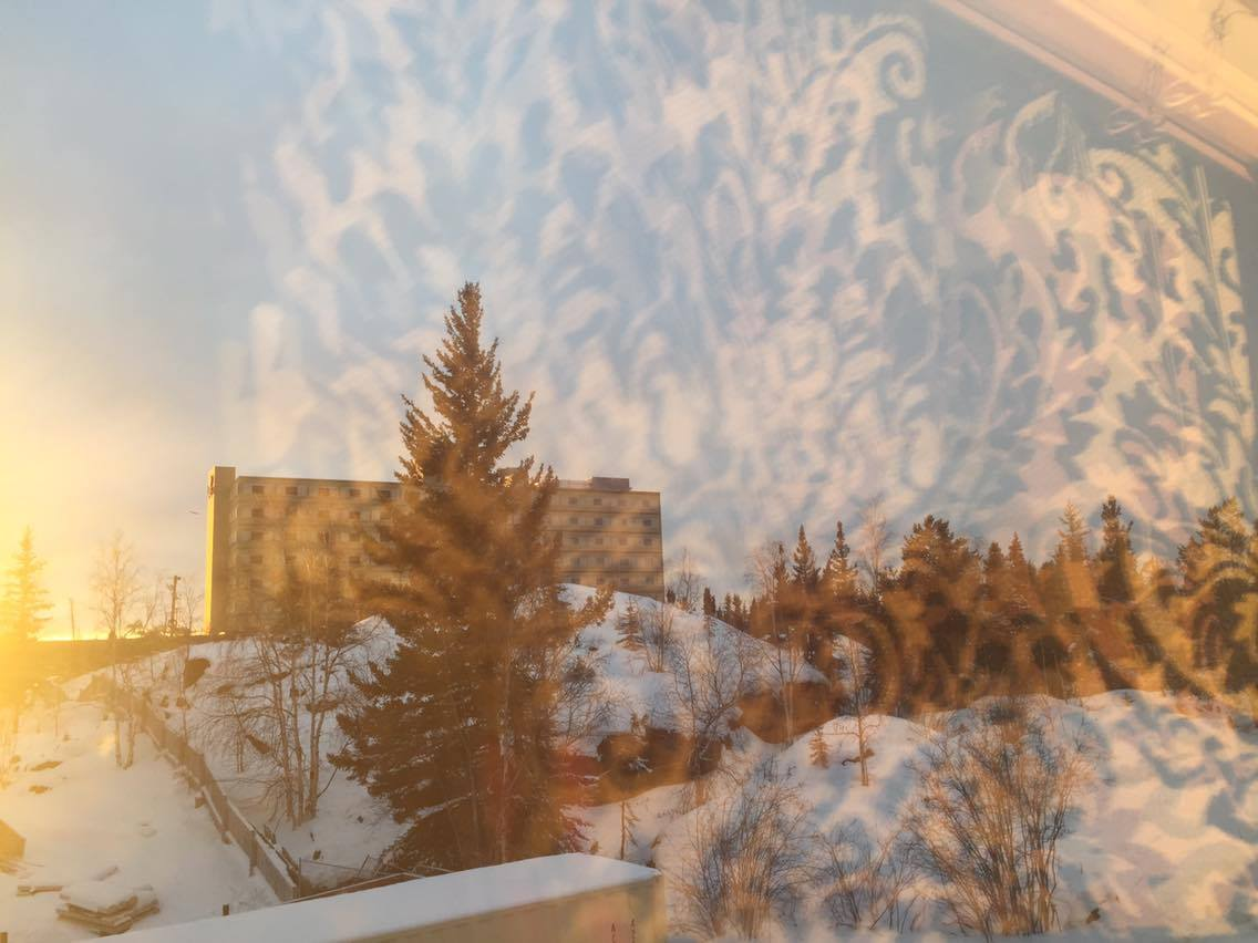 """Something of beauty in her day. """"..a quick snap where I noticed a reflection through my studio window, caused by the sun setting (at 3pm!), creeping towards the near 24hour winter darkness we experience here in the North."""""""