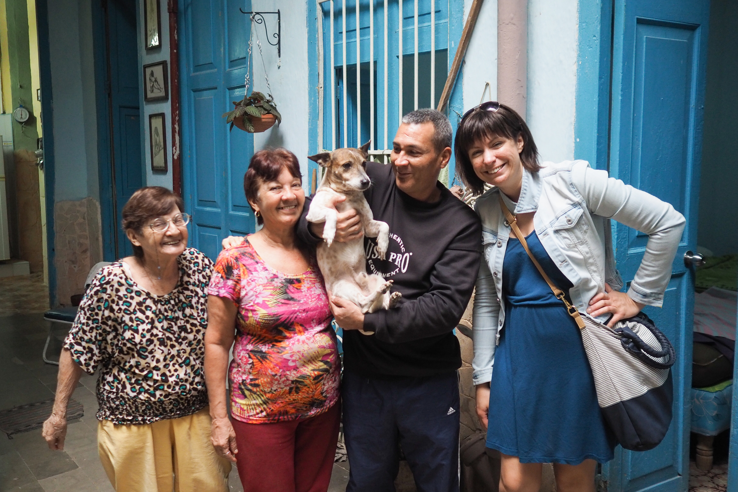 My friend Natalie (on the right) with our hosts in Havana + their sweet dog, Josi