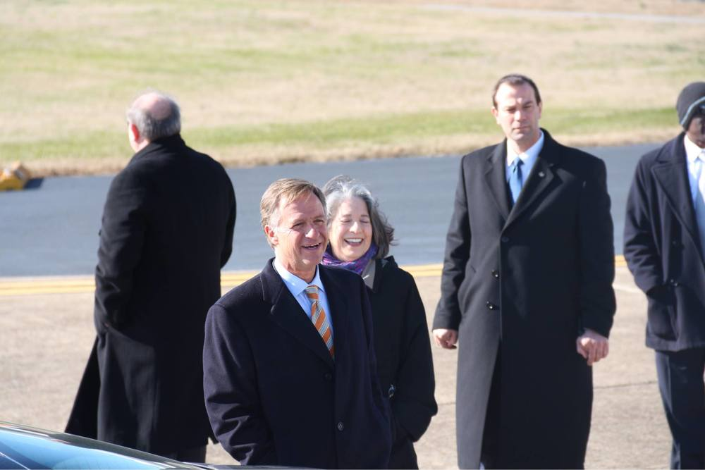 Smiling (left to right): Governor Bill Haslam (R-Tennessee) and Mayor Madeline Rogero (D-Knoxville) welcoming the president and vice president of the United States at McGhee Tyson Air National Guard Base in   Lousville, TN  , photograph by Nick Kivi