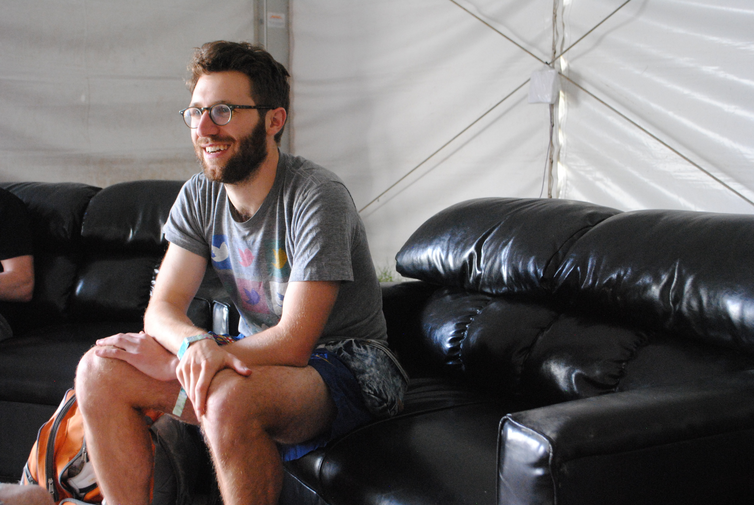 A spirited Jack Stratton, of Vulfpeck sitting down for the interview, photograph by Liam McCarty (Bonnaroo 2016)