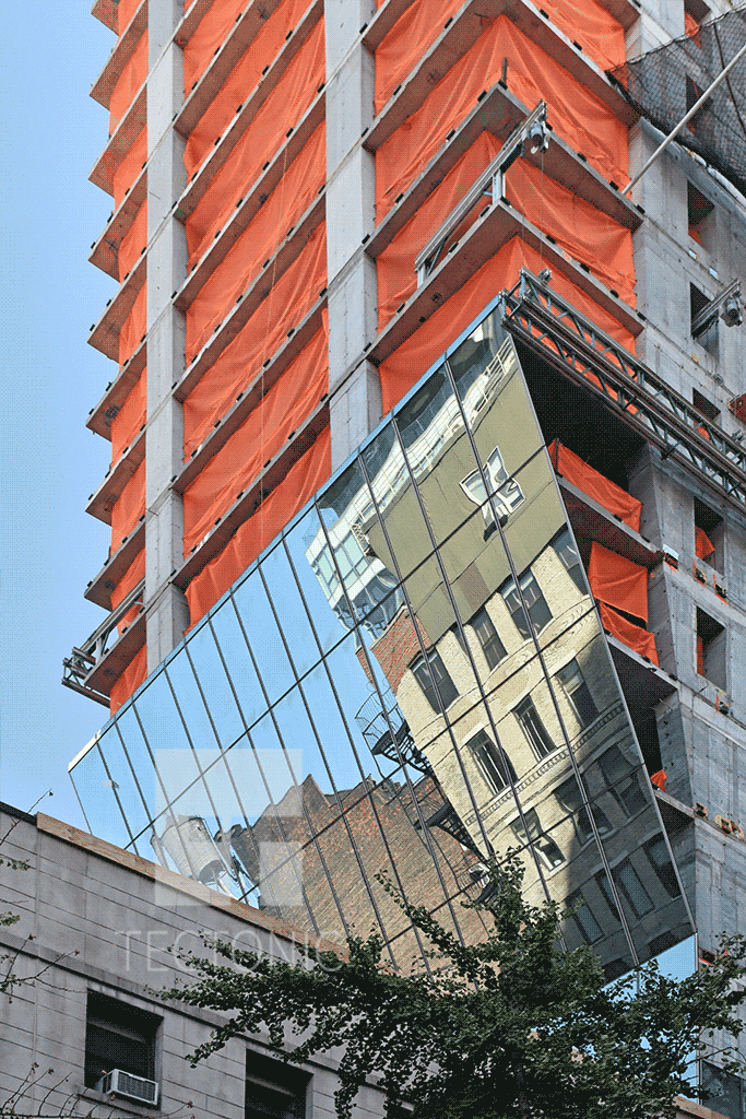 Glass facade on the underside of the  cantilever