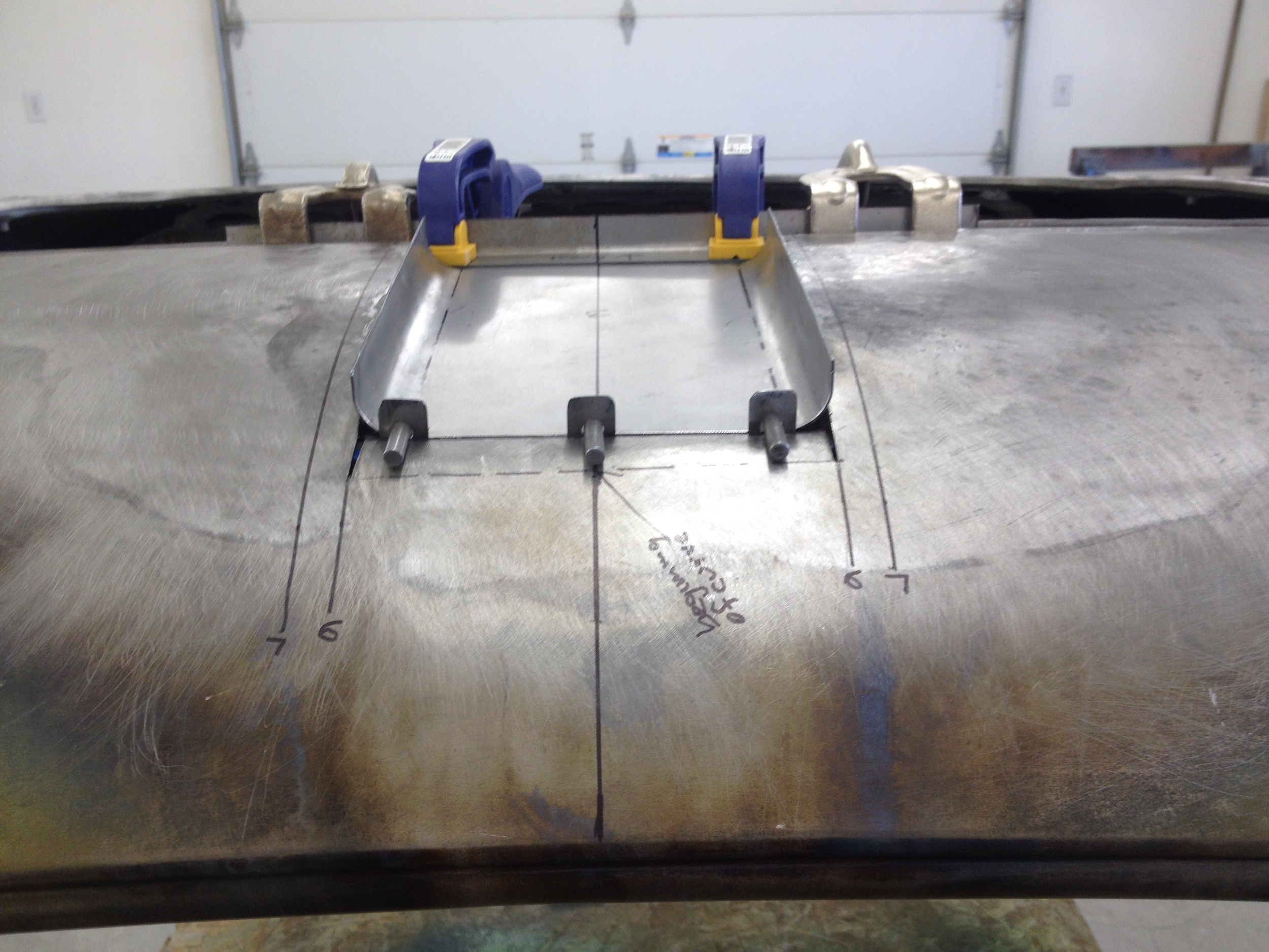 Positioning lower scoop section for welding
