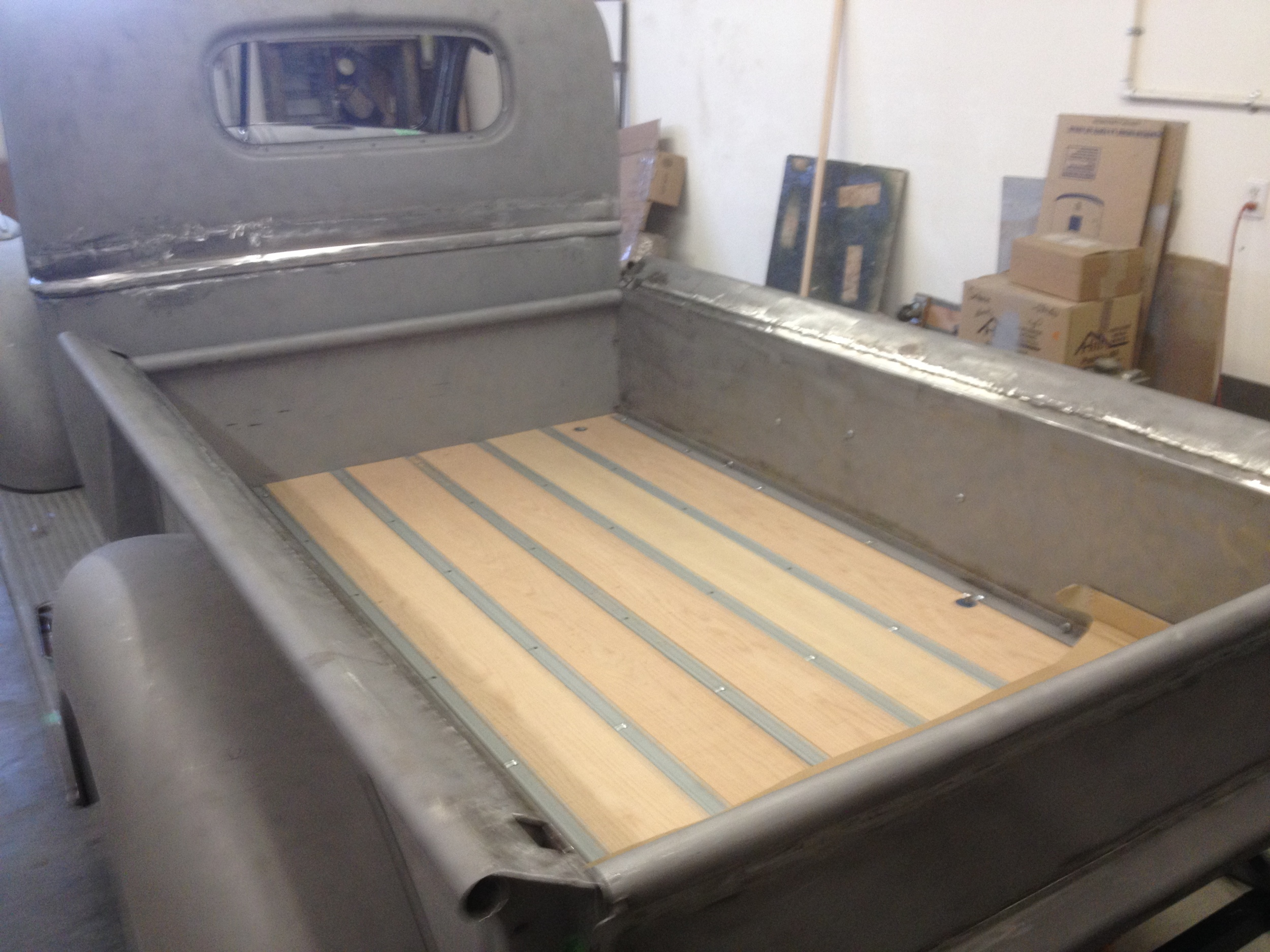 Assembly of restored panels includes installation of new bed wood.