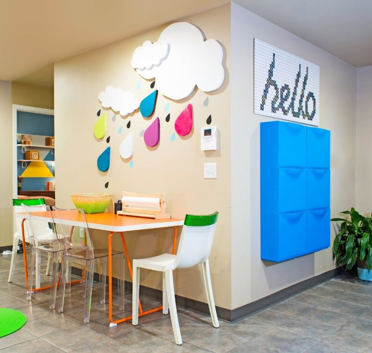 The foyer includes a place to store shoes, a table and chairs to study or create art and some cheery accents to inspire.