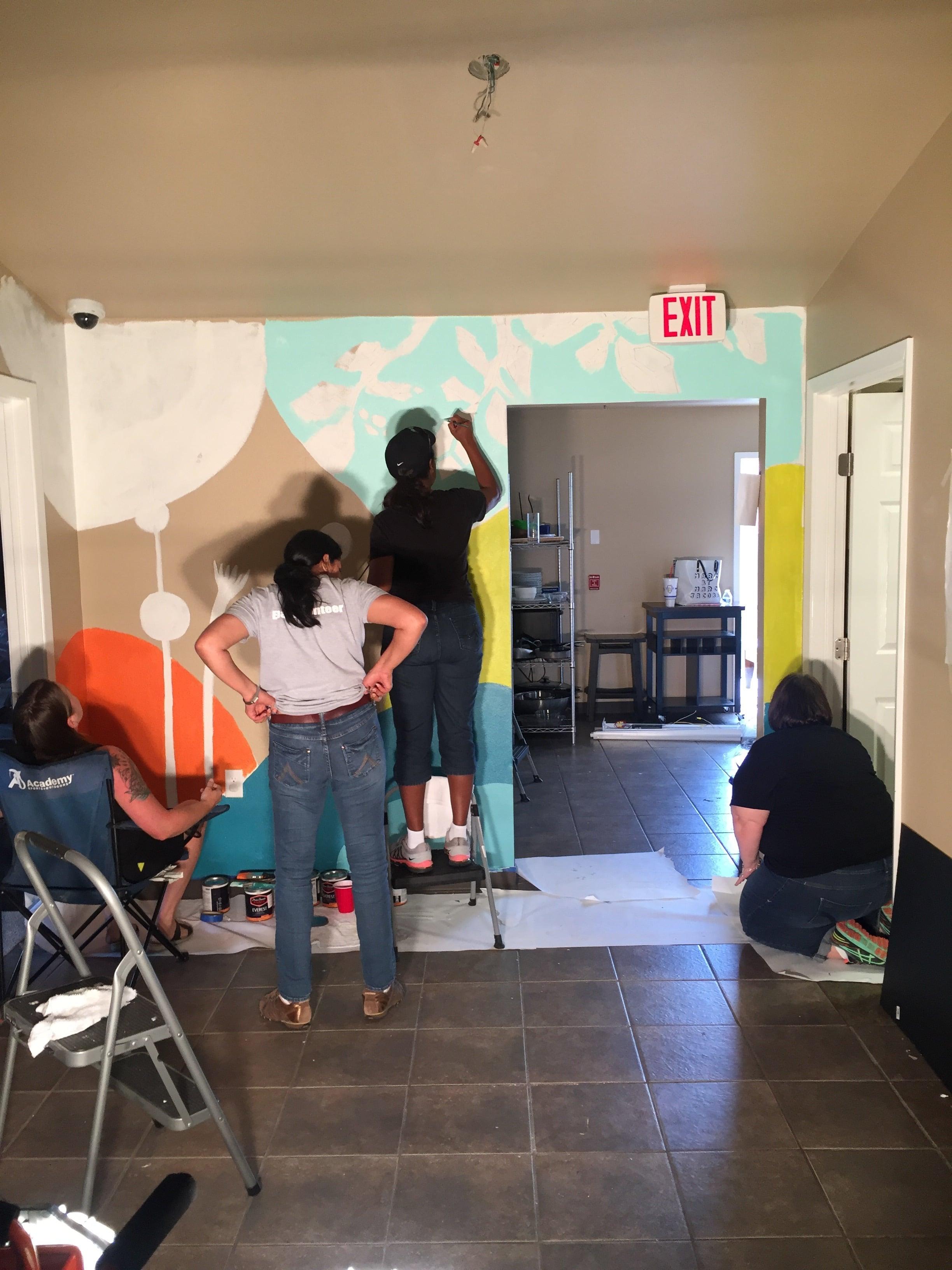 Ebay volunteers helping with the mural