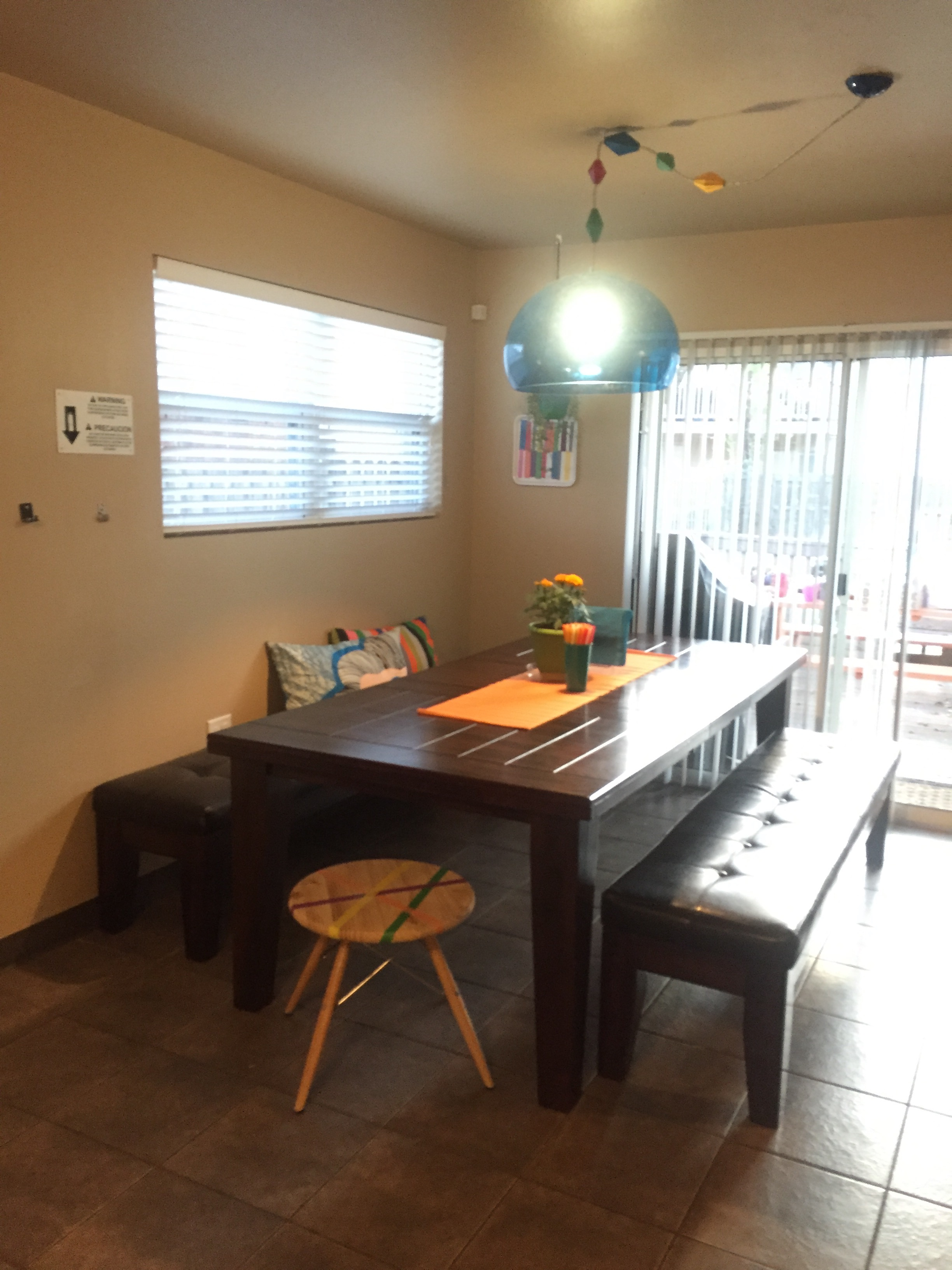 The kitchen was brightened with new lighting, pillows, and a few pops of color