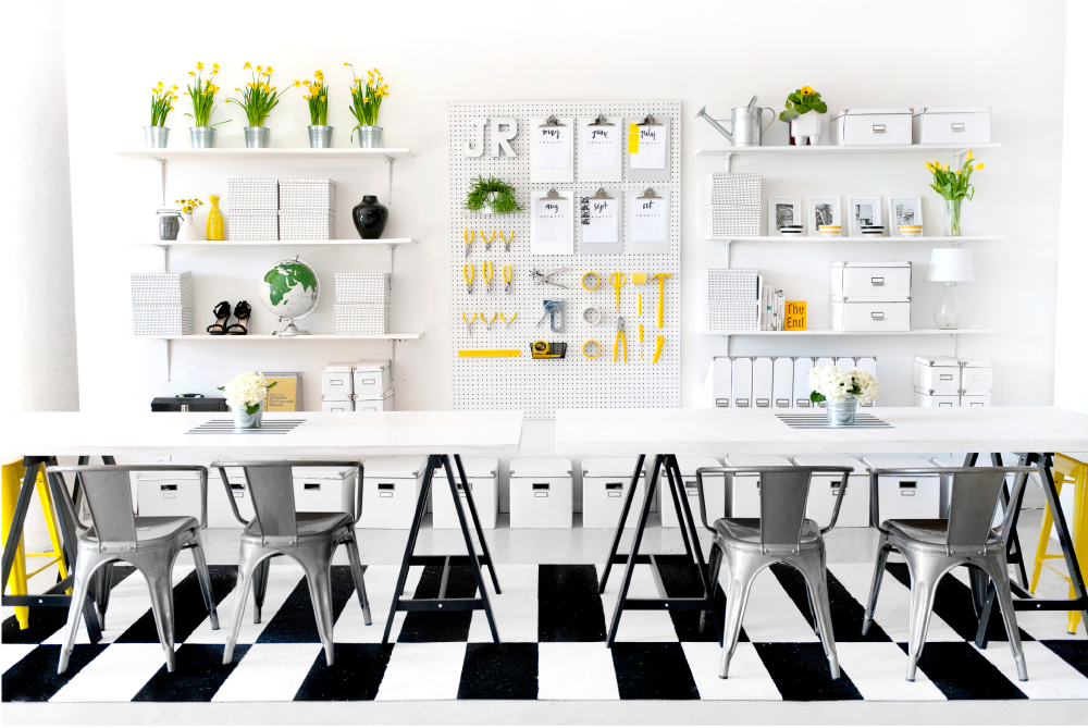 black and white graphic floors + white shelves and walls + pops of color  (source)