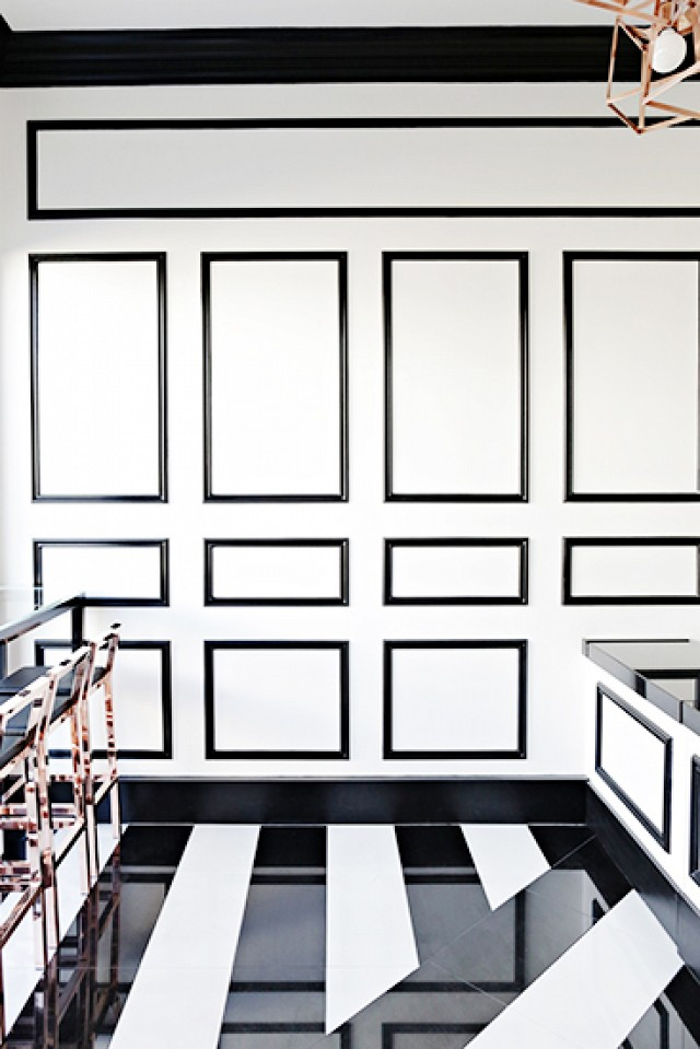 black and white graphic floor + graphic wall moldings - but without the actual wood moldings  (source)